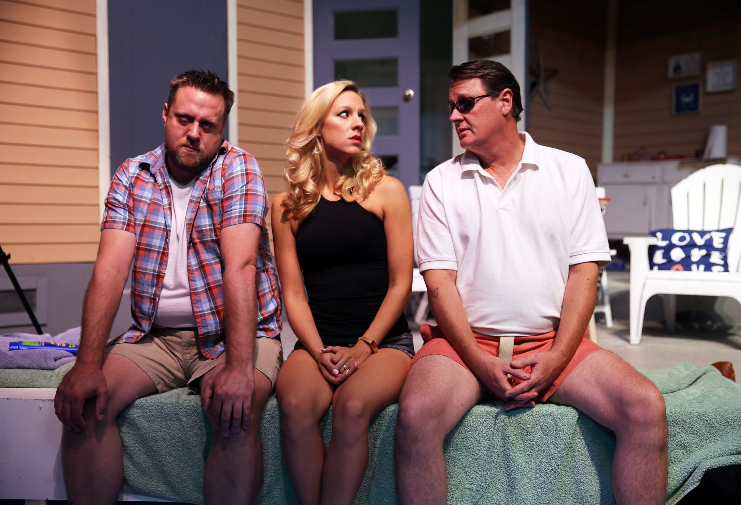"Eric Rawski, left, Candice Kogut and Richard Lambert star in ""Lips Together, Teeth Apart"" by Terrance McNally (Courtesy of New Phoenix Theatre)"