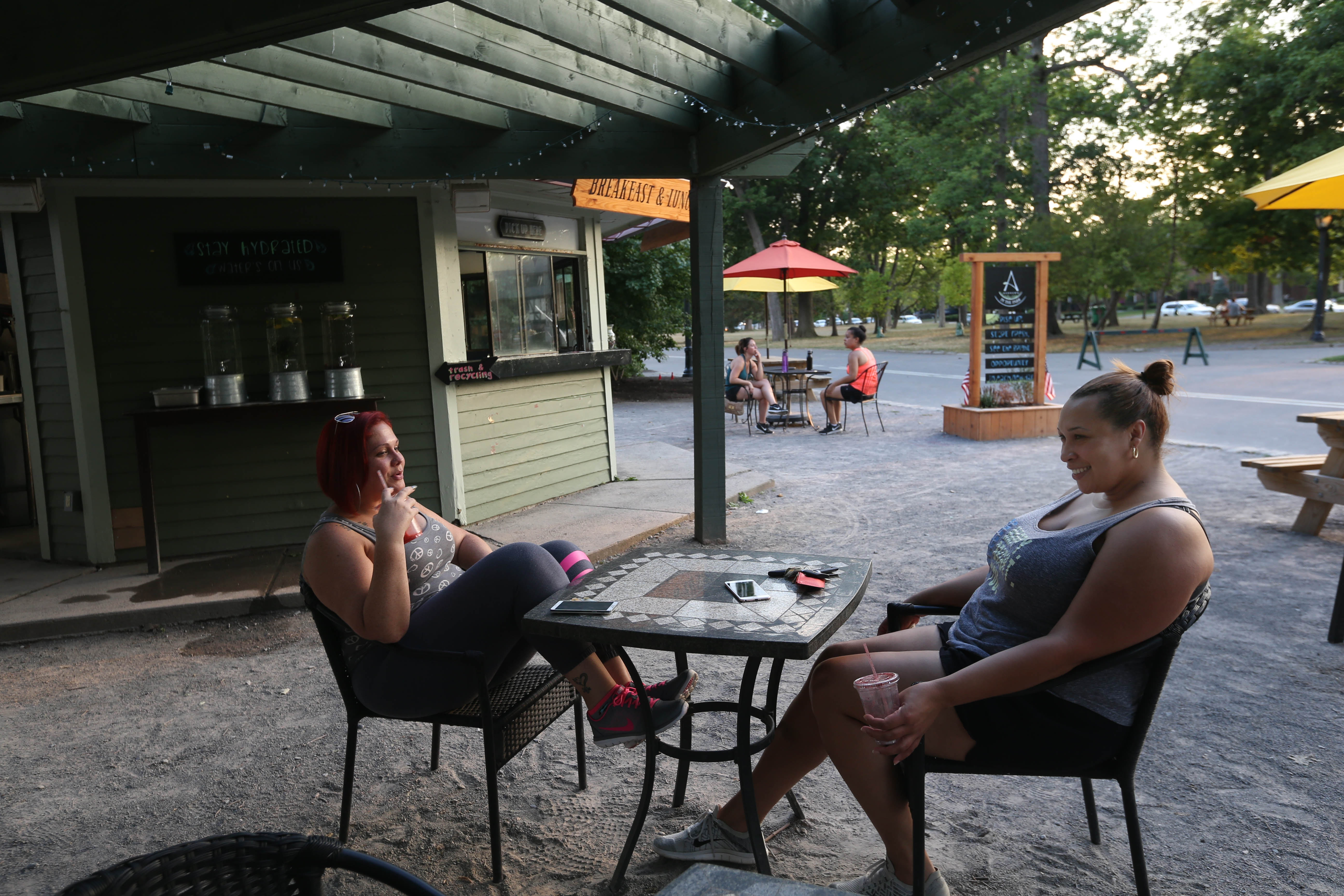 The Meadow at Delaware Park in Buffalo is abuzz with activity seven days a week throughout the year. Photos on a typical day at the beloved Olmsted park, Thursday, Aug. 4, 2016. Ann Marie Hernandez, left, and Natalie Gates, of Kenmore, have some smoothies from Ashker's in the Park after their walk. (Sharon Cantillon/Buffalo News)