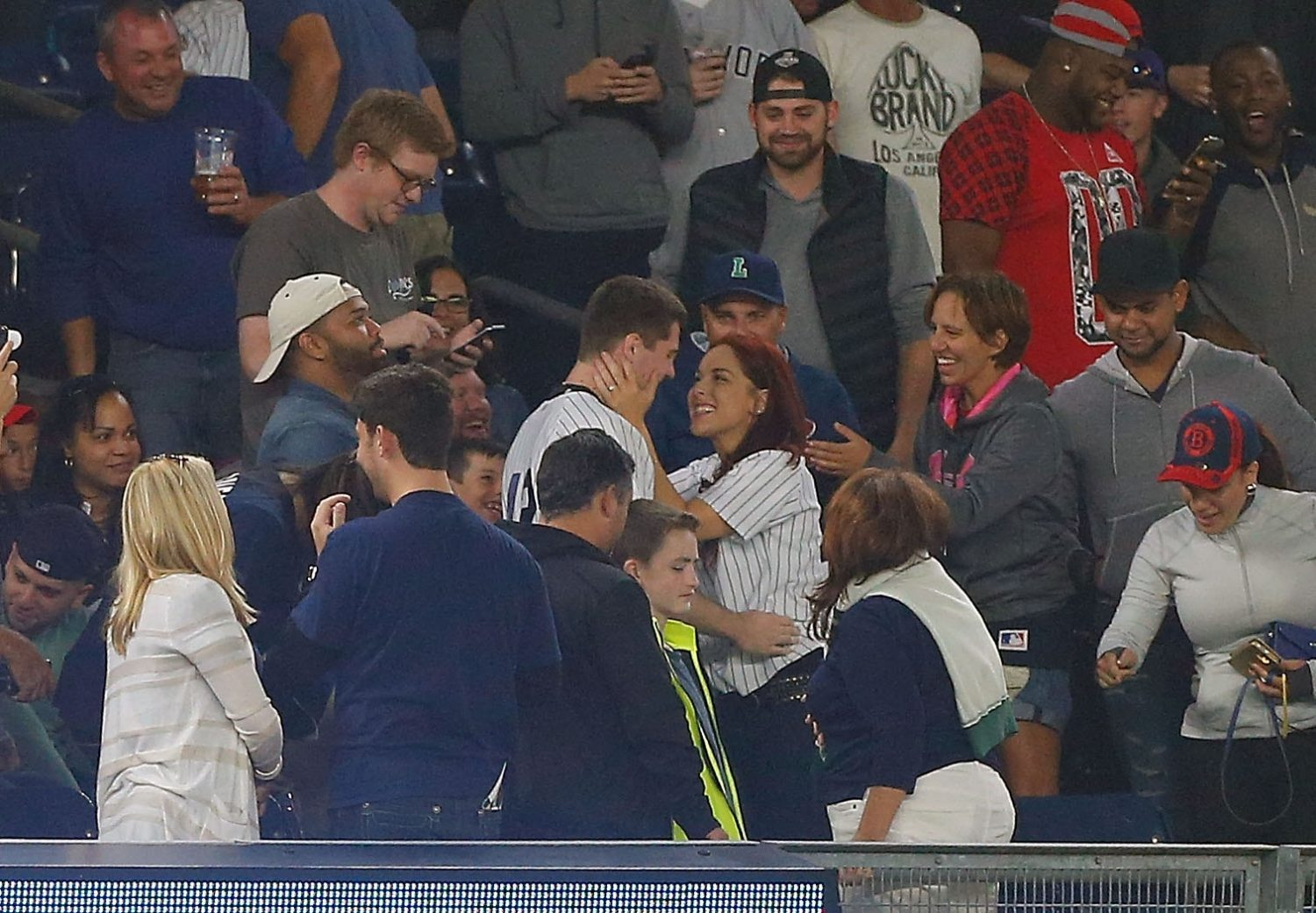 Heather Terwilliger of Fredonia got engaged to Andrew Fox Tuesday night in the upper deck during a game between the New York Yankees and the Boston Red Sox at Yankee Stadium. The proposal was delayed when Fox dropped the ring, then found it, all of which was witnessed by fans. (Photo by Jim McIsaac/Getty Images)