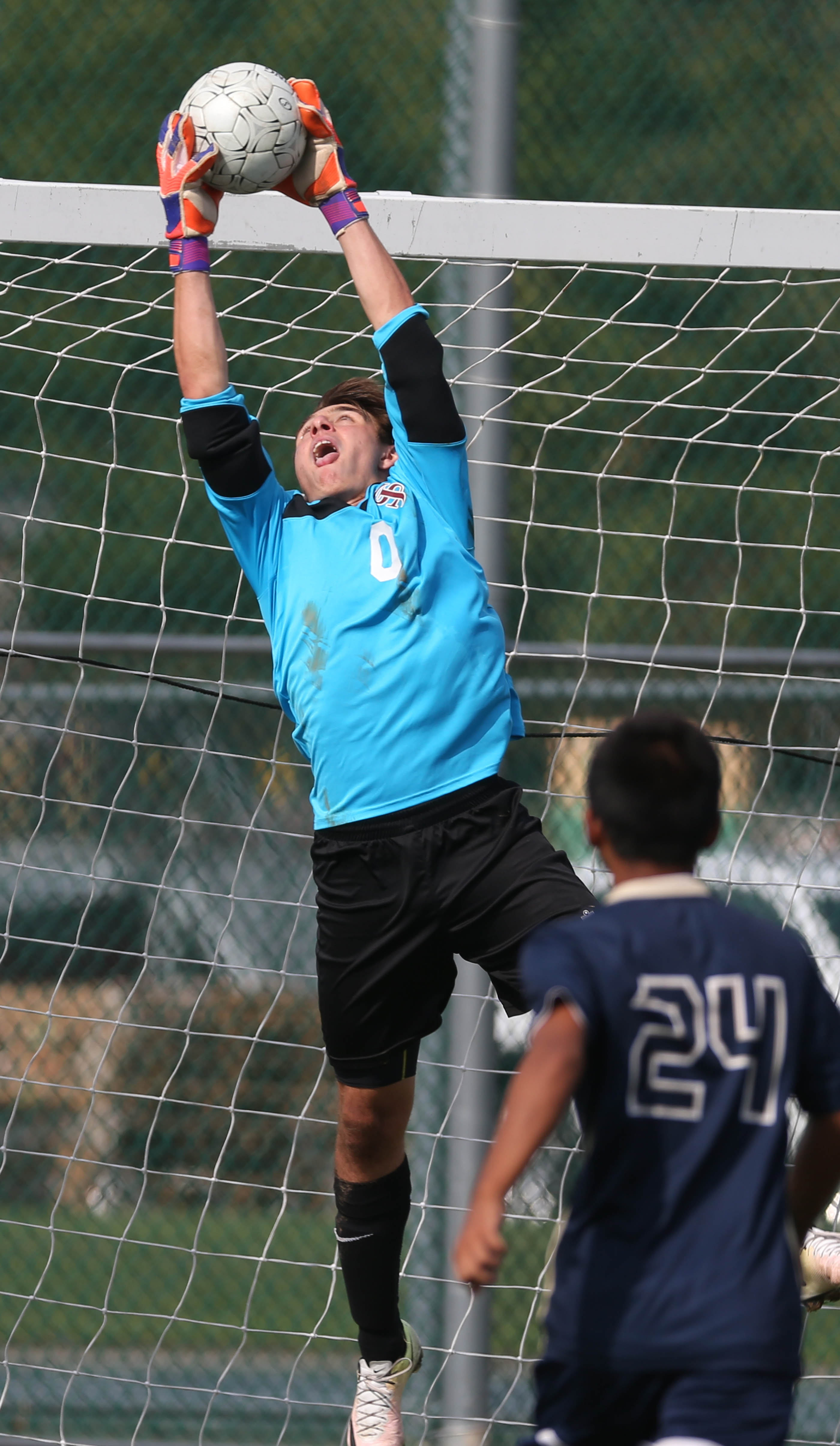 St. Joe's goalkeeper Carmine Tronalone makes a save against International Prep in the Clarence Tournament.