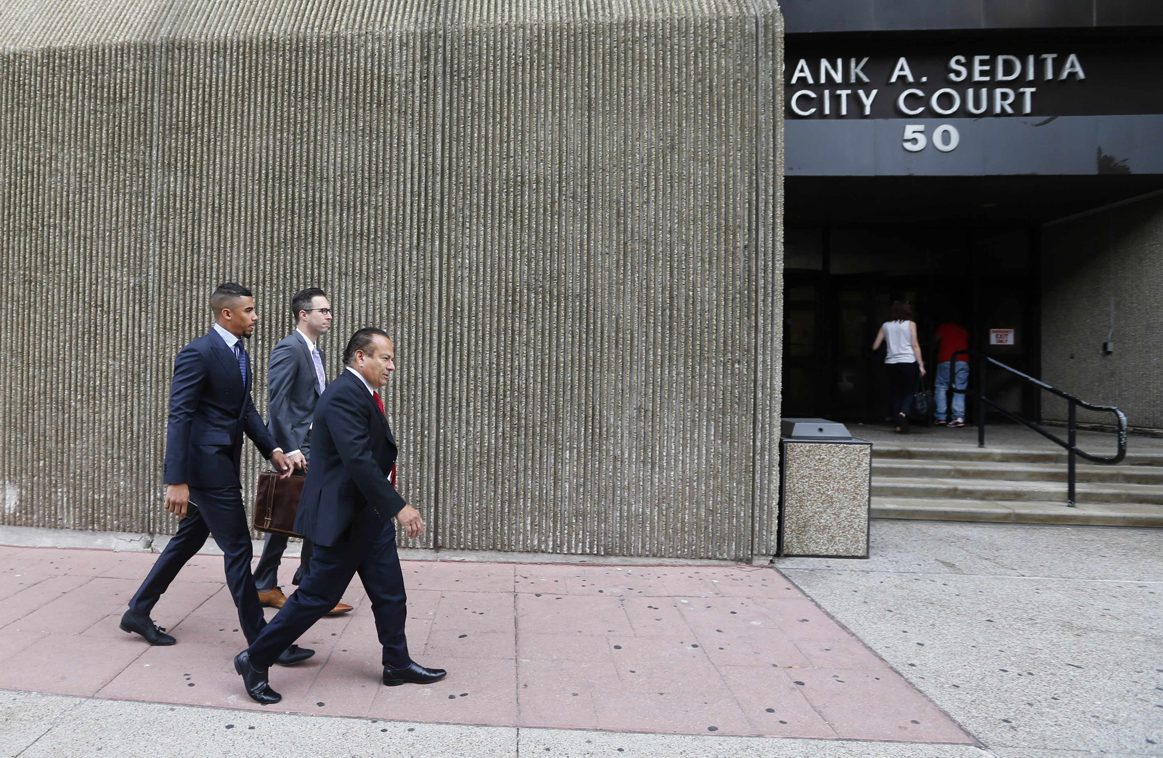 Buffalo Sabres forward Evander Kane enters city court with his attorneys on Aug. 1, 2016.