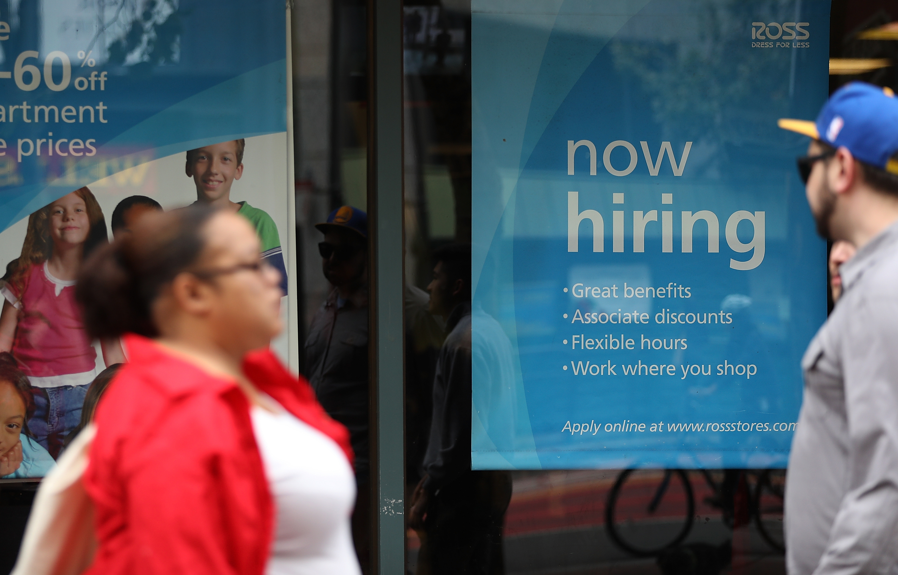 A 'now hiring' sign is posted outside of a Ross Dress for Less store in San Francisco. (Getty Images)