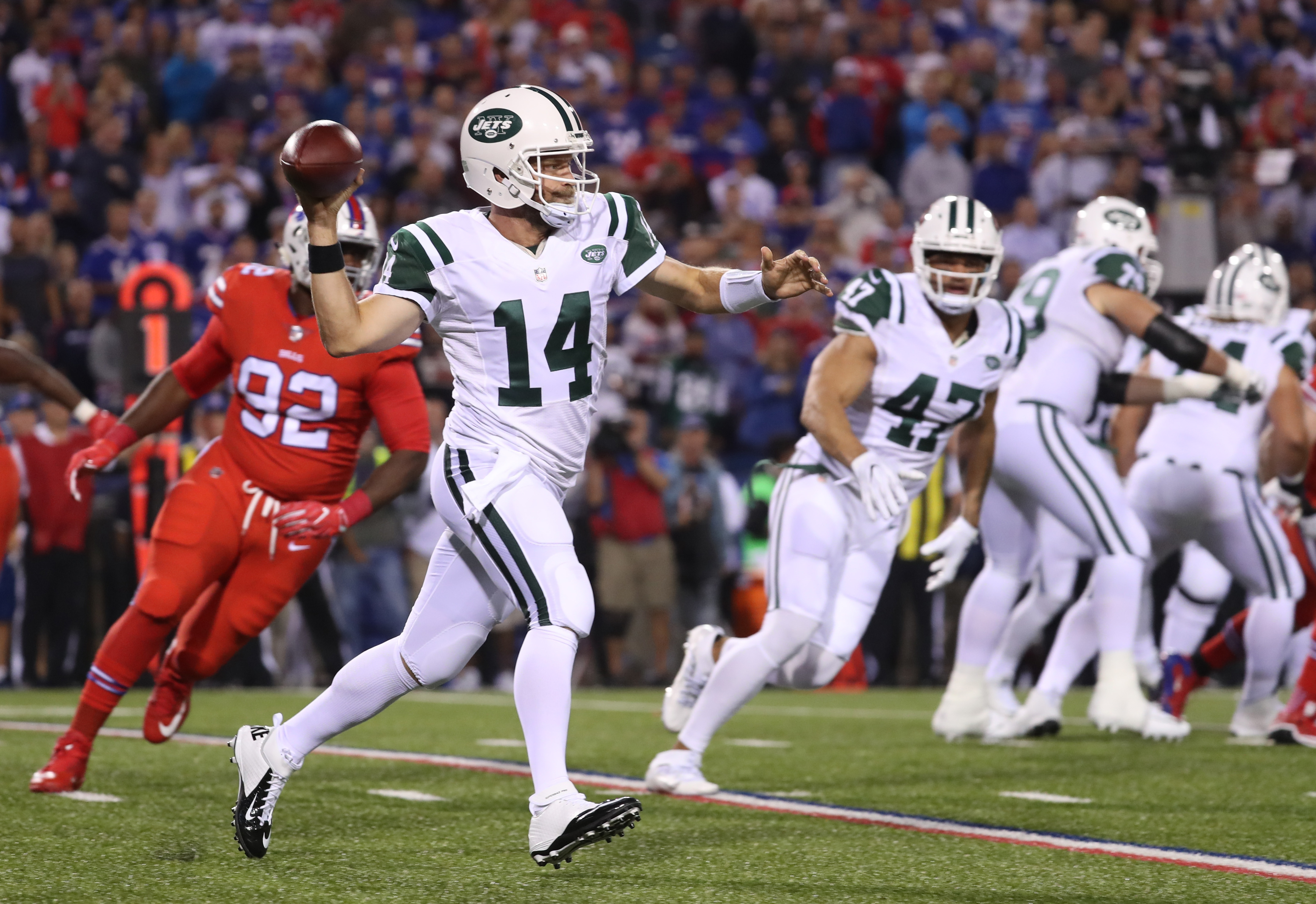 Jets quarterback Ryan Fitzpatrick (14) , who came into the game with a 1-8 career record against Rex Ryan's defenses, redeemed himself with a sensational passing performance in the Jets' 37-31 victory. (James P. McCoy/Buffalo News)