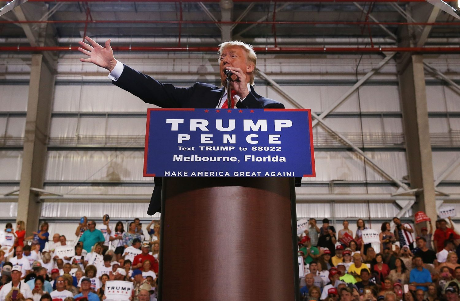 Republican presidential nominee Donald Trump speaks to supporters Tuesday at a Florida airport hangar the day after his first debate with Democratic nominee Hillary Clinton. (Photo by Spencer Platt/Getty Images)