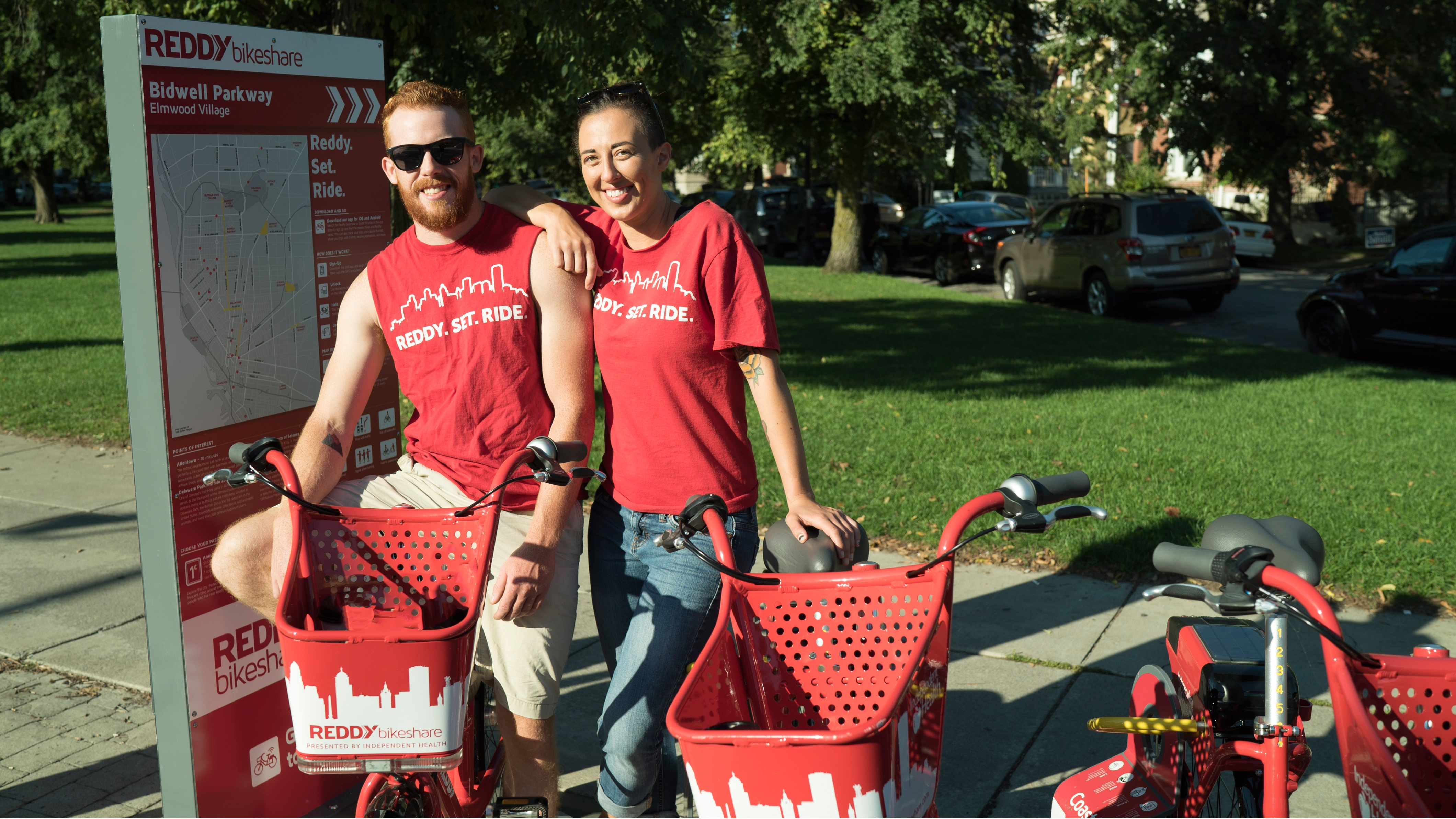 Fleet manager Nate Schultz and communications executive Jennifer White get ready for a ride with Reddy bikeshare.