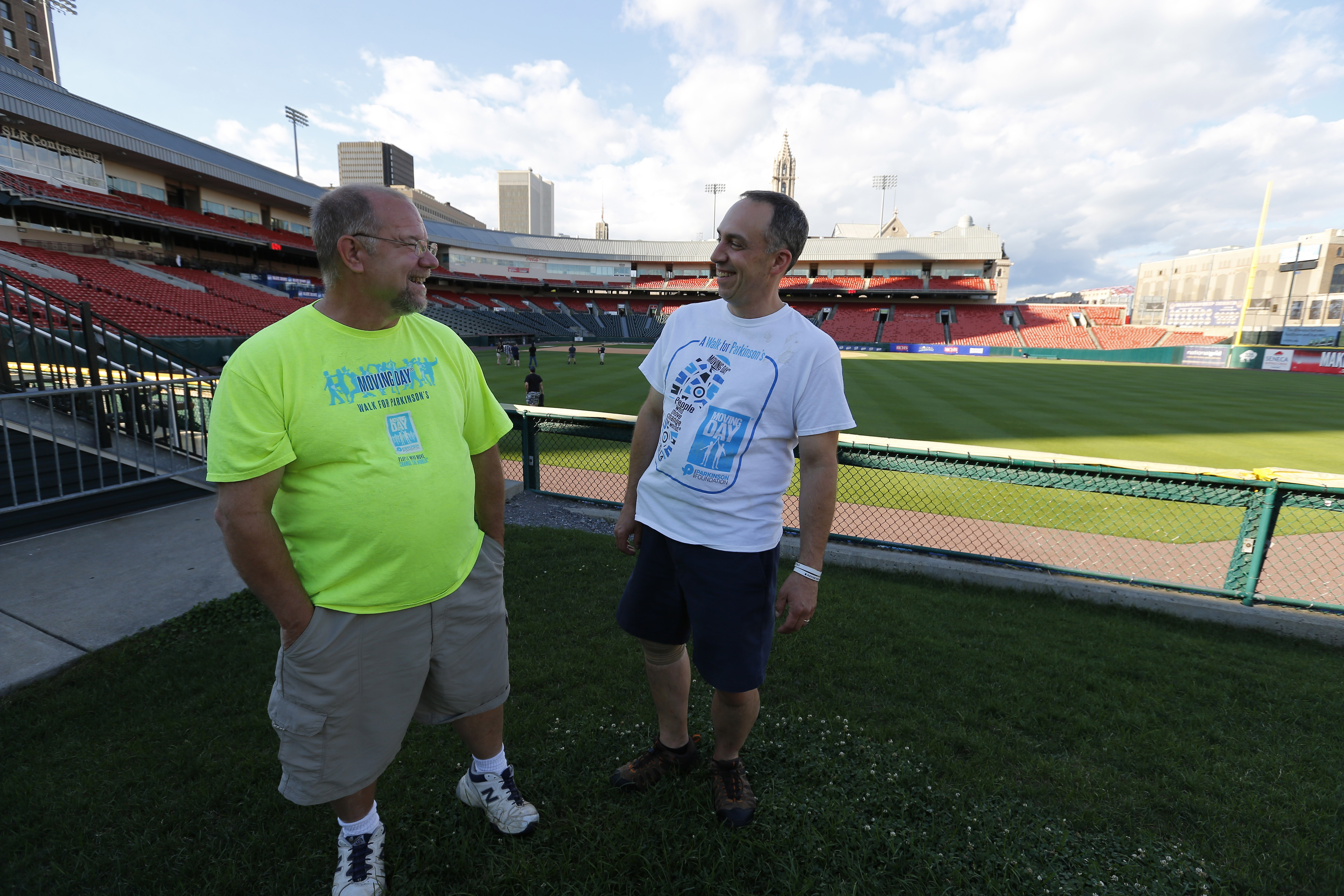 """Robert """"Bob"""" Russell, left, was the """"face"""" of Moving Day in 2015. He's with Jim Schaefer, who will be the """"face"""" of this year's Moving Day event on Sept. 11 at Coca Cola Field. (Mark Mulville/Buffalo News)"""
