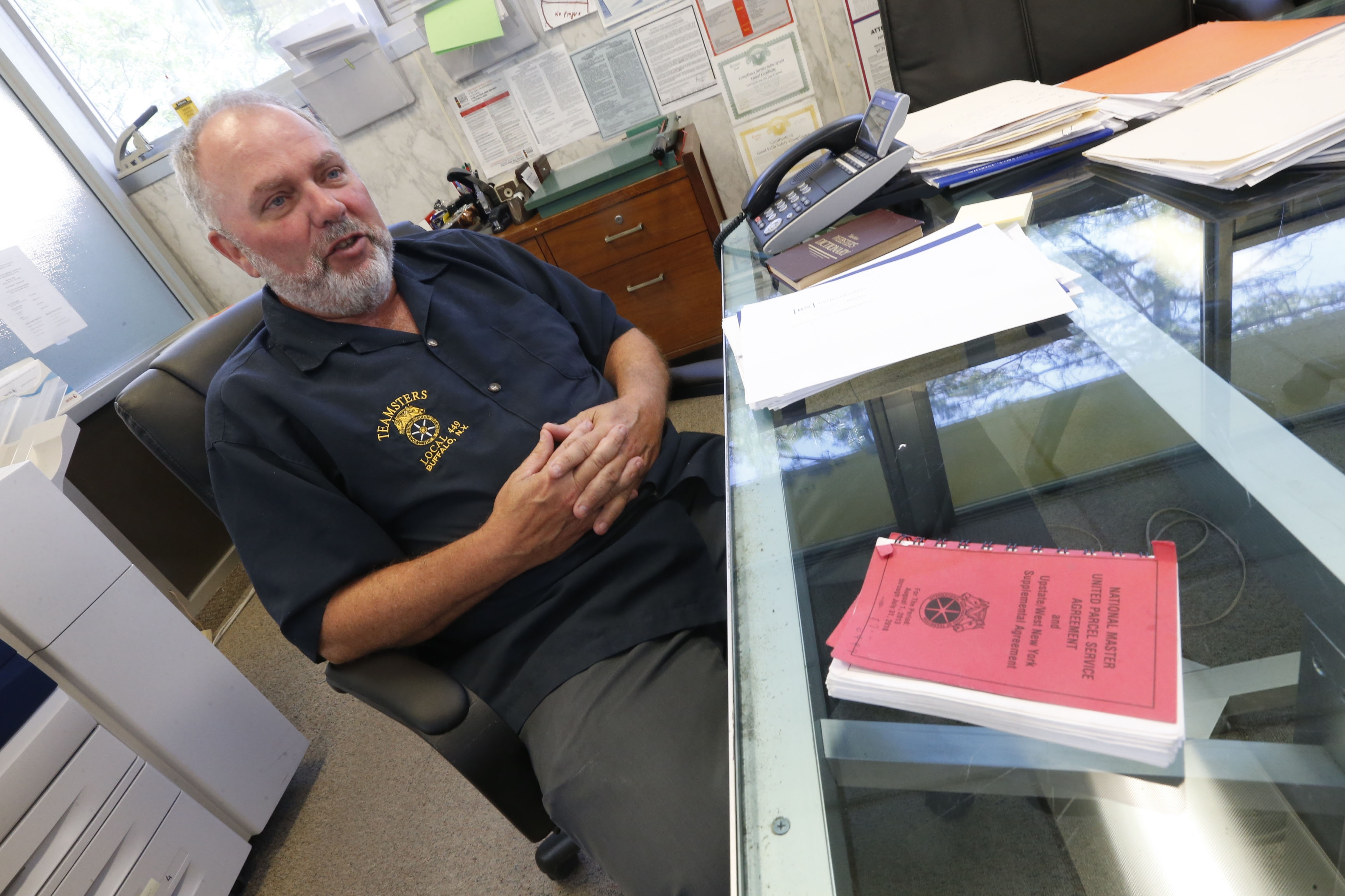 """""""I think the state of organized labor in Western New York is good, better than the nation, but it can always be better."""" – George Harrigan, principal officer of Teamsters Local 449 at his office"""