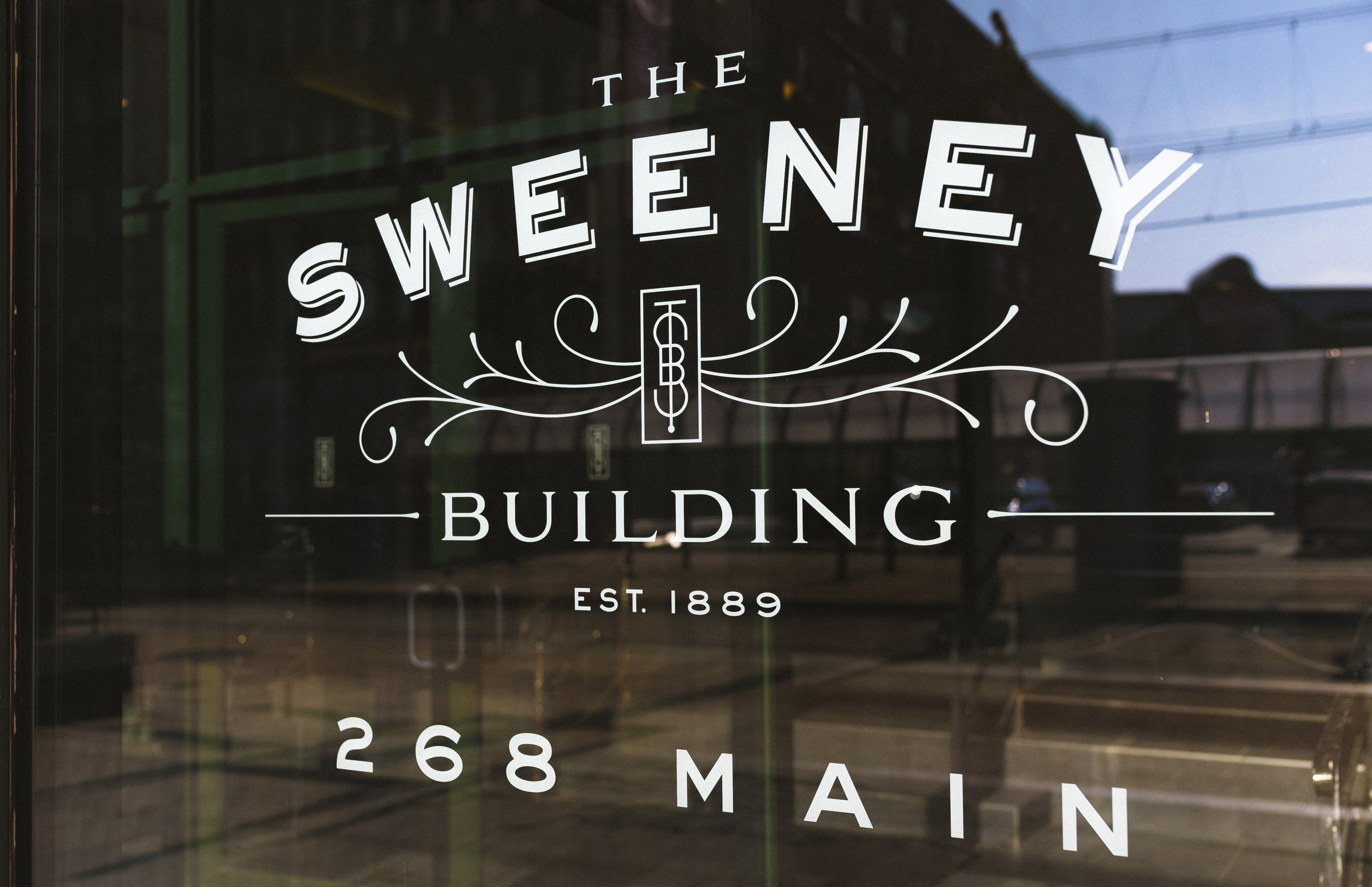 New owners of a six-story building at 268 Main St., Buffalo, which previously was just called 268 Main, renamed it The Sweeney Building, recalling The Sweeney Company Department Store that was one of the buildingþÄôs first occupants in the early 1900s. Three partners of Crowley Webb, a Buffalo-based advertising agency that leases space there, purchased the structure in April 2016. (Courtesy of Nolan Whipple)