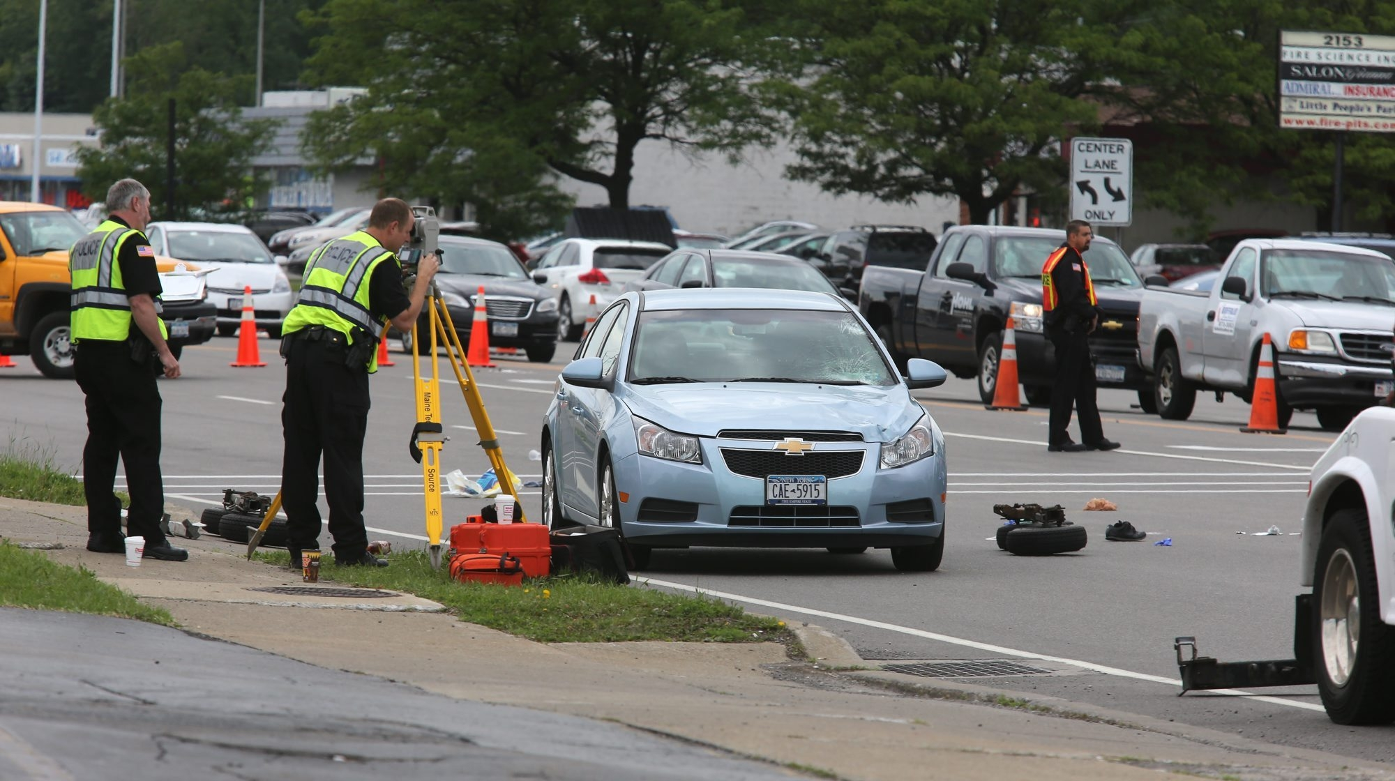 Police with a damaged vehicle at the scene of a fatal pedestrian-car accident on Niagara Falls Boulevard in the Town of Tonawanda, Wednesday, June 5, 2013. (News file photo)