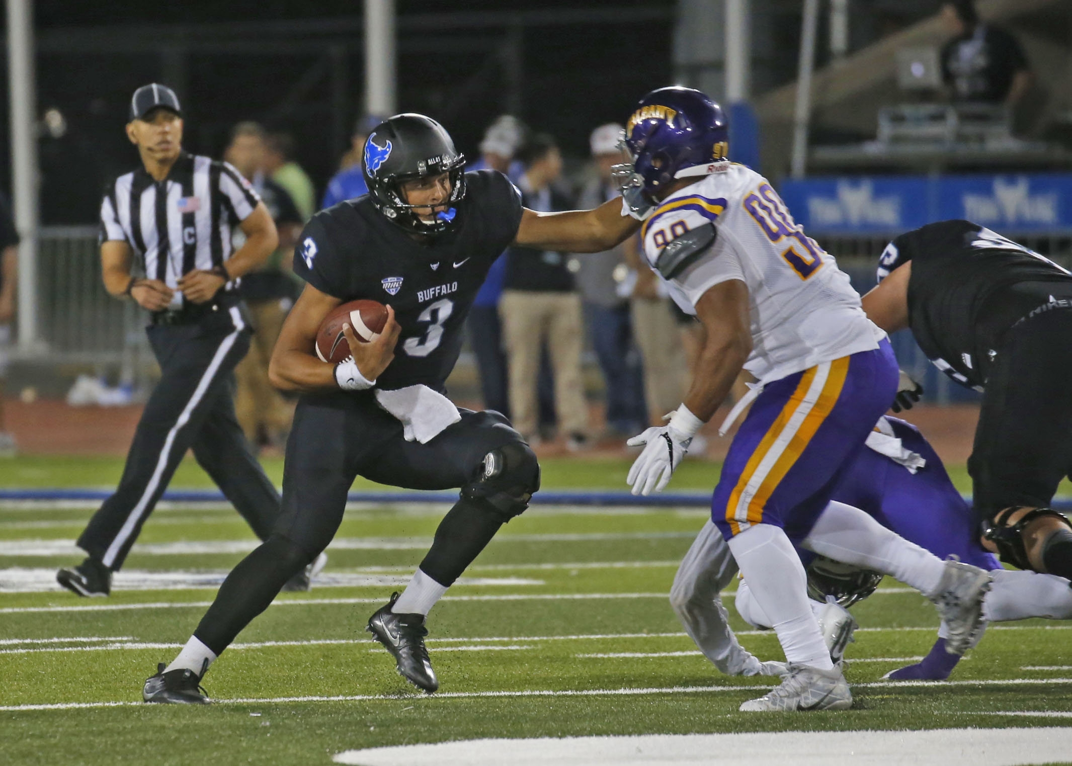 UB quarterback Tyree Jackson tries to grab some yards on a keeper during Friday night's game at UB Stadium.