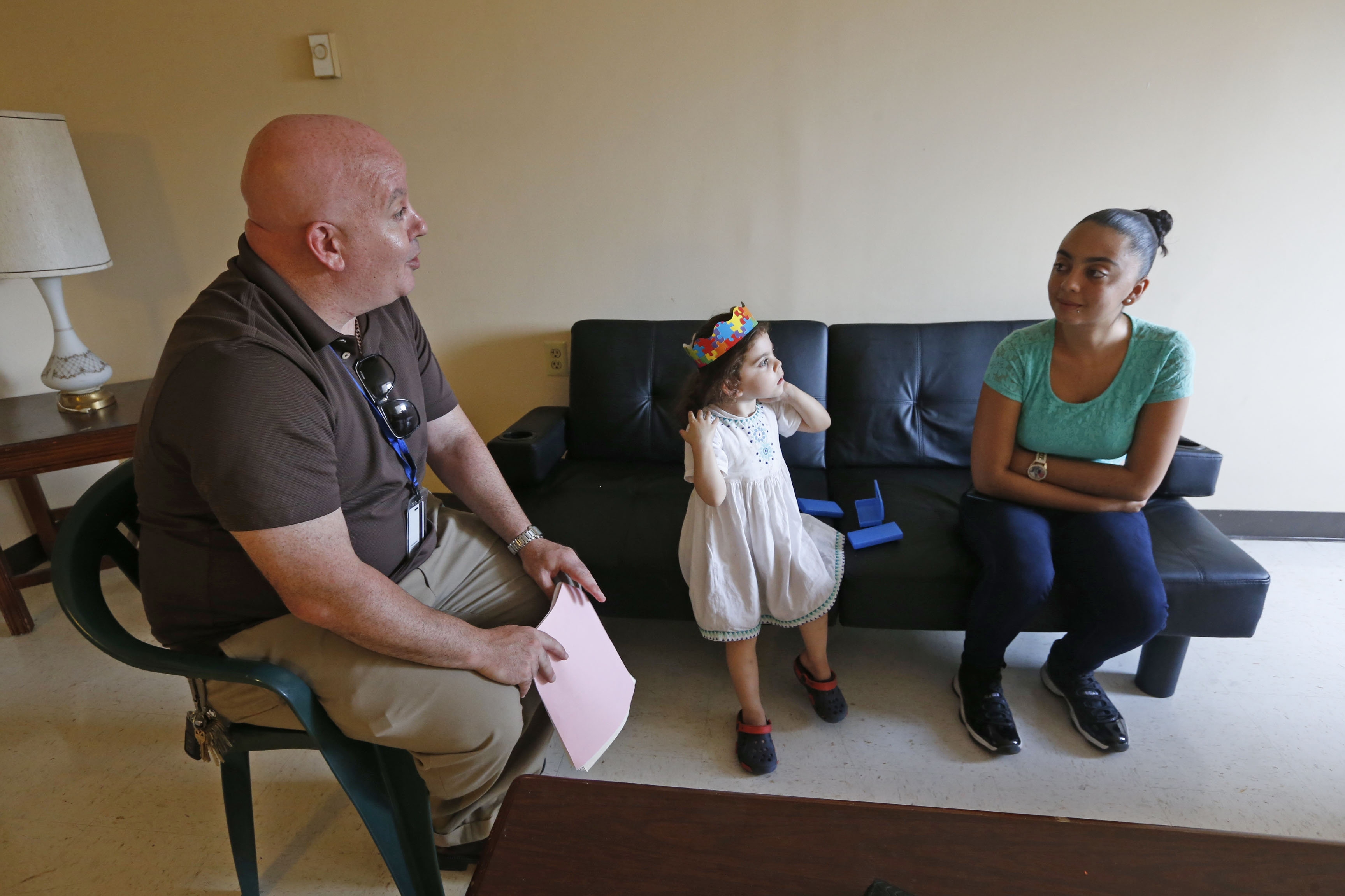 John Starkey, left, the new principal at Lafayette International High School, with his daughter Mia Luz, 3, visit the apartment of Hector Virella in the Santa Maria Towers apartments, and his daughter Angelica Viyella Torres, 19, right, and tries to persuade her to come to his school.  This was on Tuesday, Aug. 30, 2016.  The population of his school is about 50 percent Hispanic students and 50 percent refugees, and a majority of Buffalo has focused a lot on the refugee population. John Starkey, the new principal of Lafayette International HS, is trying to ensure his Hispanic students (almost all Puerto Rican) feel welcome and wanted at the new high school, as well, by going on visits to these students' homes and felowshiping with them in their community.  (Robert Kirkham/Buffalo News)