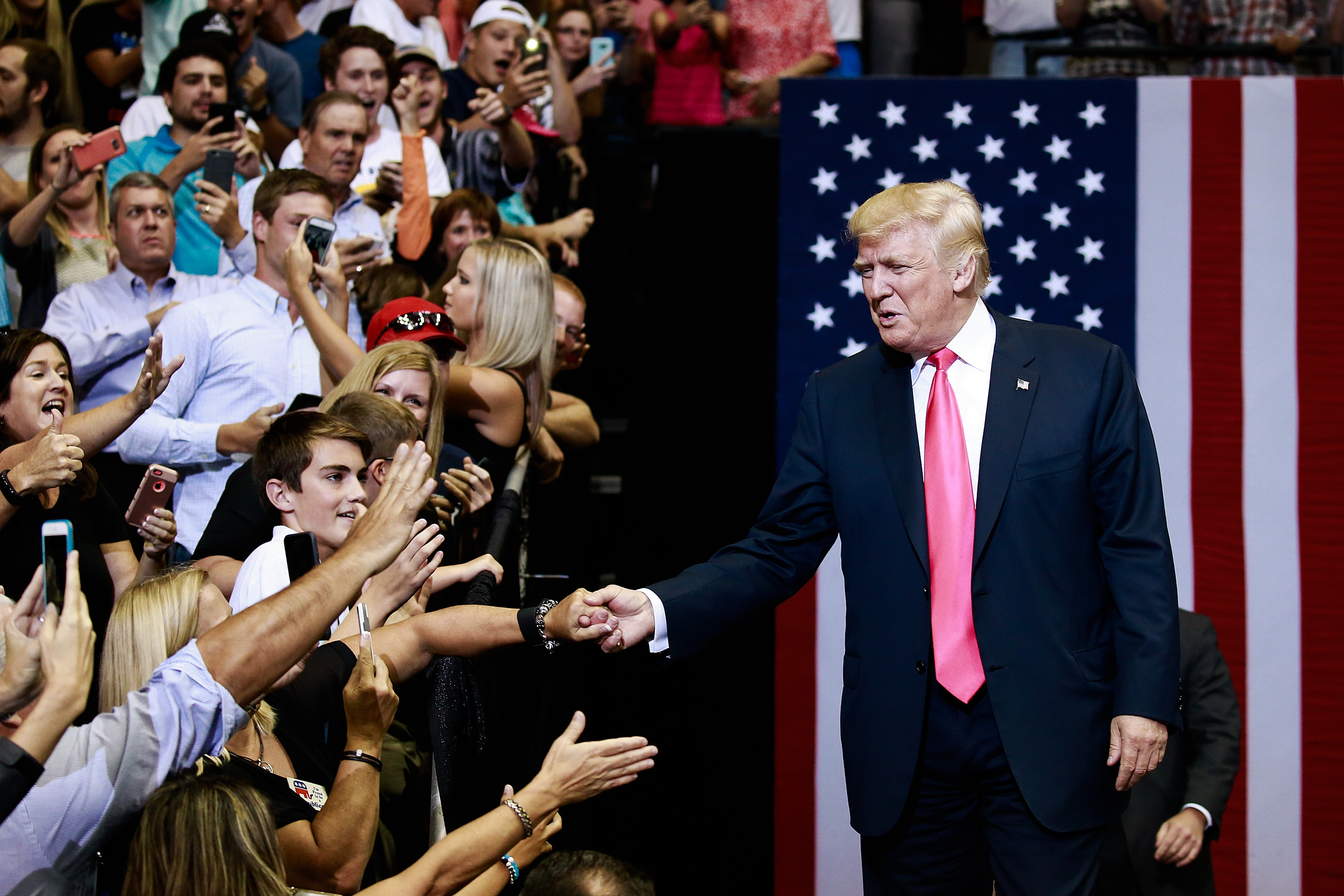 Donald Trump, the Republican presidential nominee, arrives to speak at a campaign rally in Jacksonville, Fla., last month. Trump has had to toss aside his aversion to germs and shake hands with members of the public on the campaign trail.