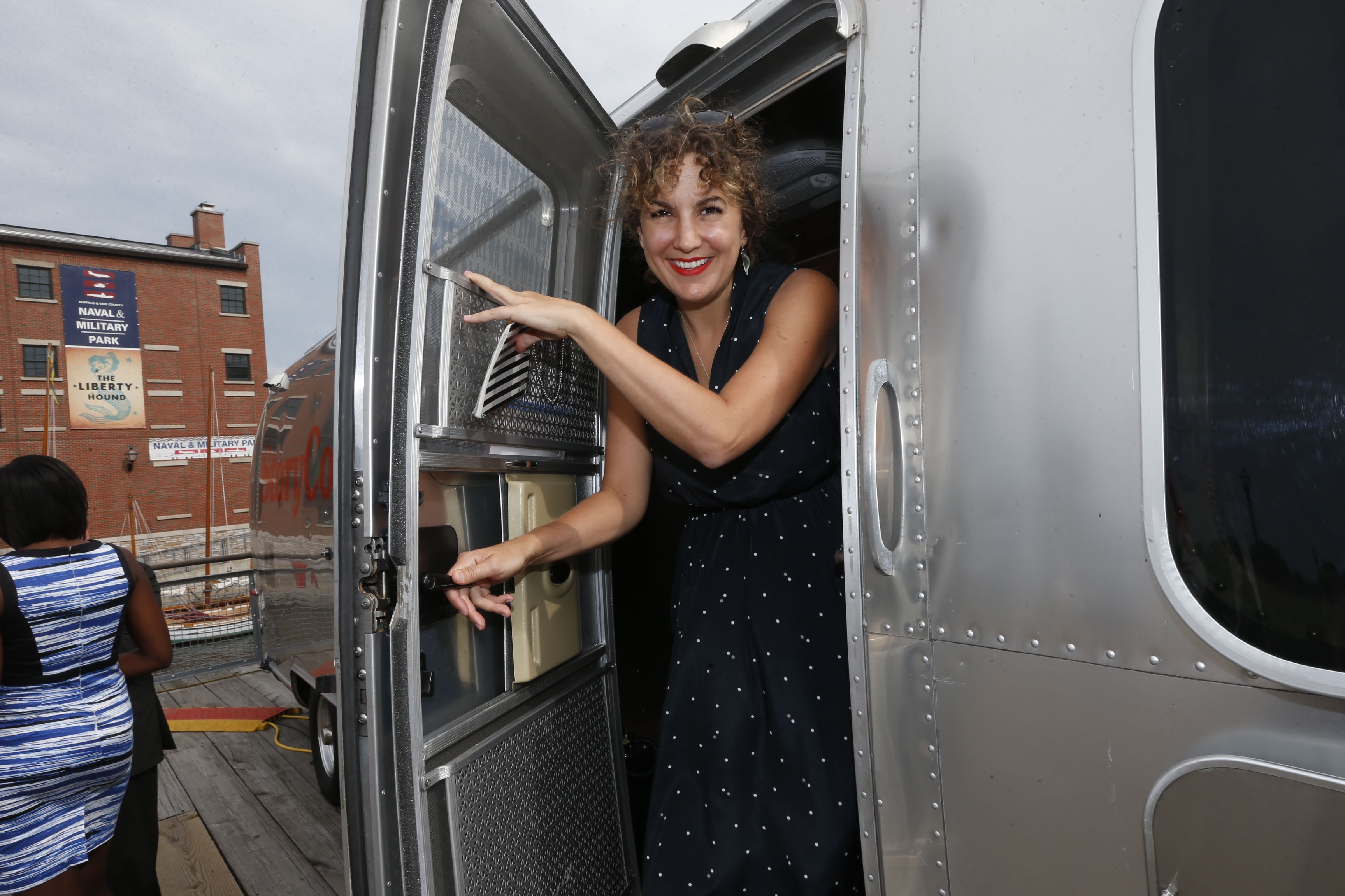 Stacey Todd, mobile tour site manager, on Thursday shows off the traveling StoryCorps trailer, where participants record their stories.