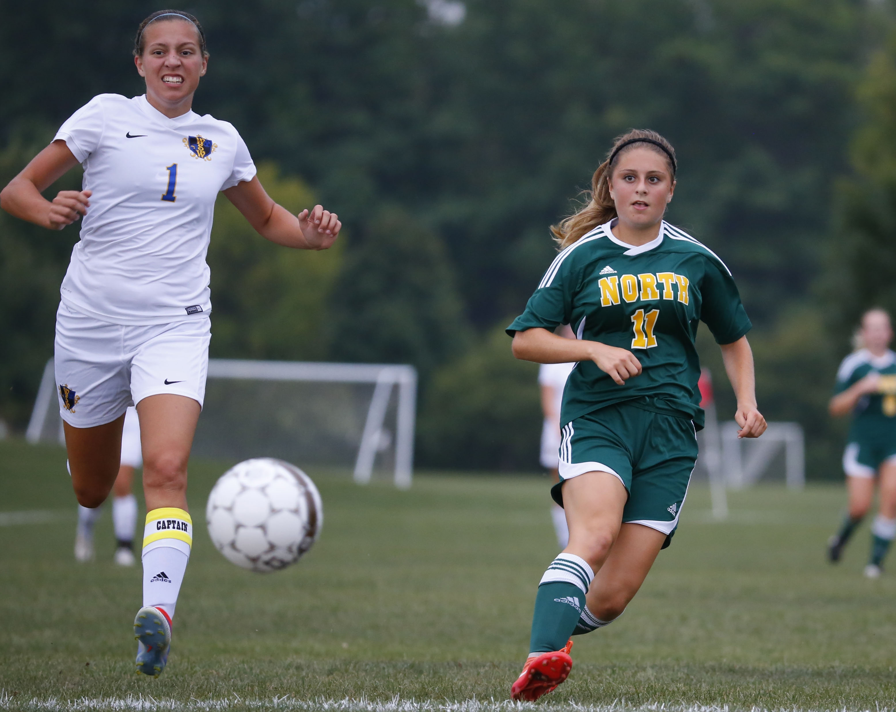 Williamsville North's Samantha Diamond beat West Seneca West's Paige Cocina for a first-half goal.