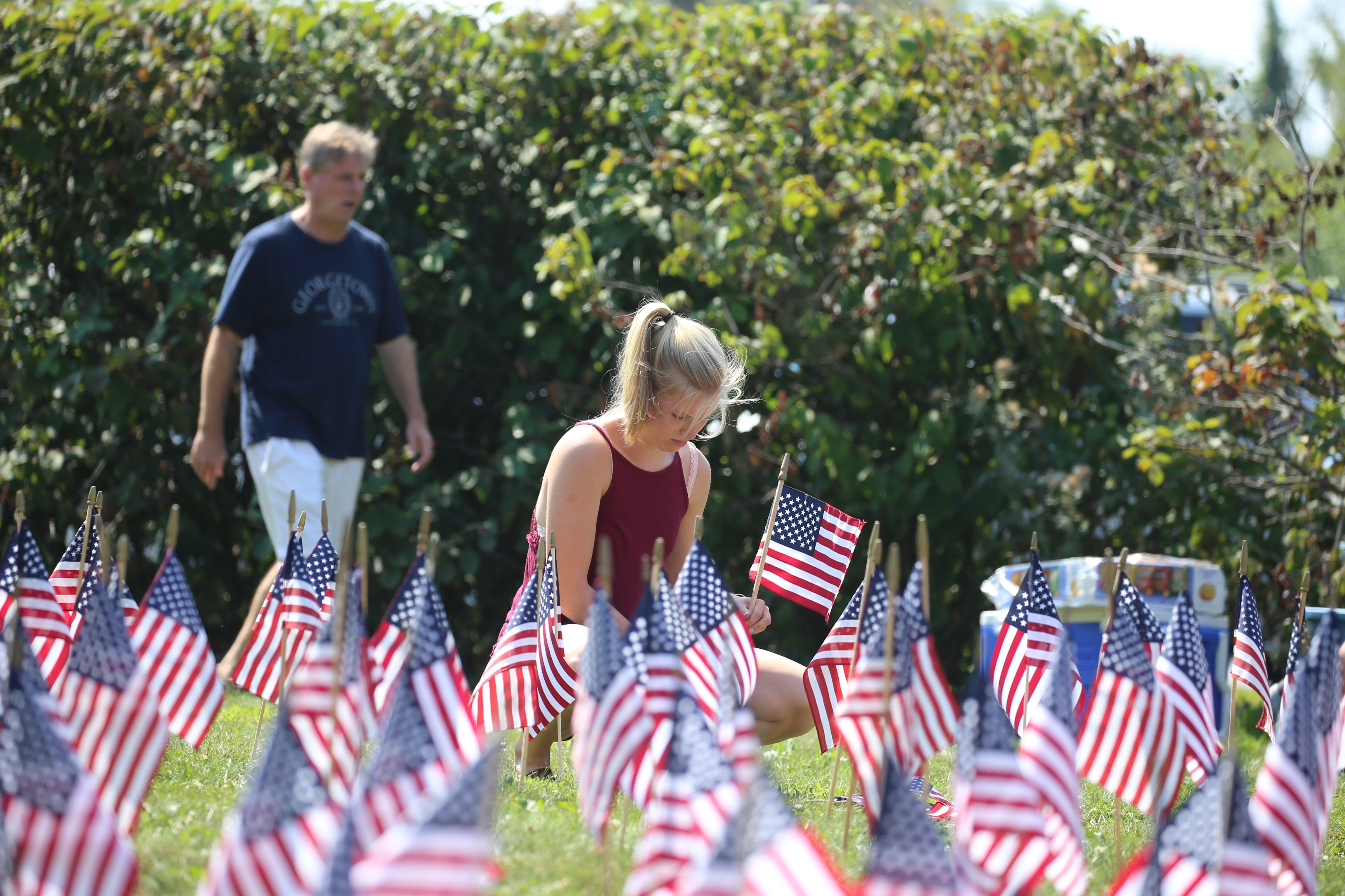 Kathryn Yoder of Amherst, a volunteer with Western New York Families of September 11th, last Septebmer helped place 3,000 miniature flags on the lawn of the Buffalo headquarters of the Red Cross on Delaware Avenue to honor the victims of the Sept. 11 attacks. (John Hickey/Buffalo News file photo)