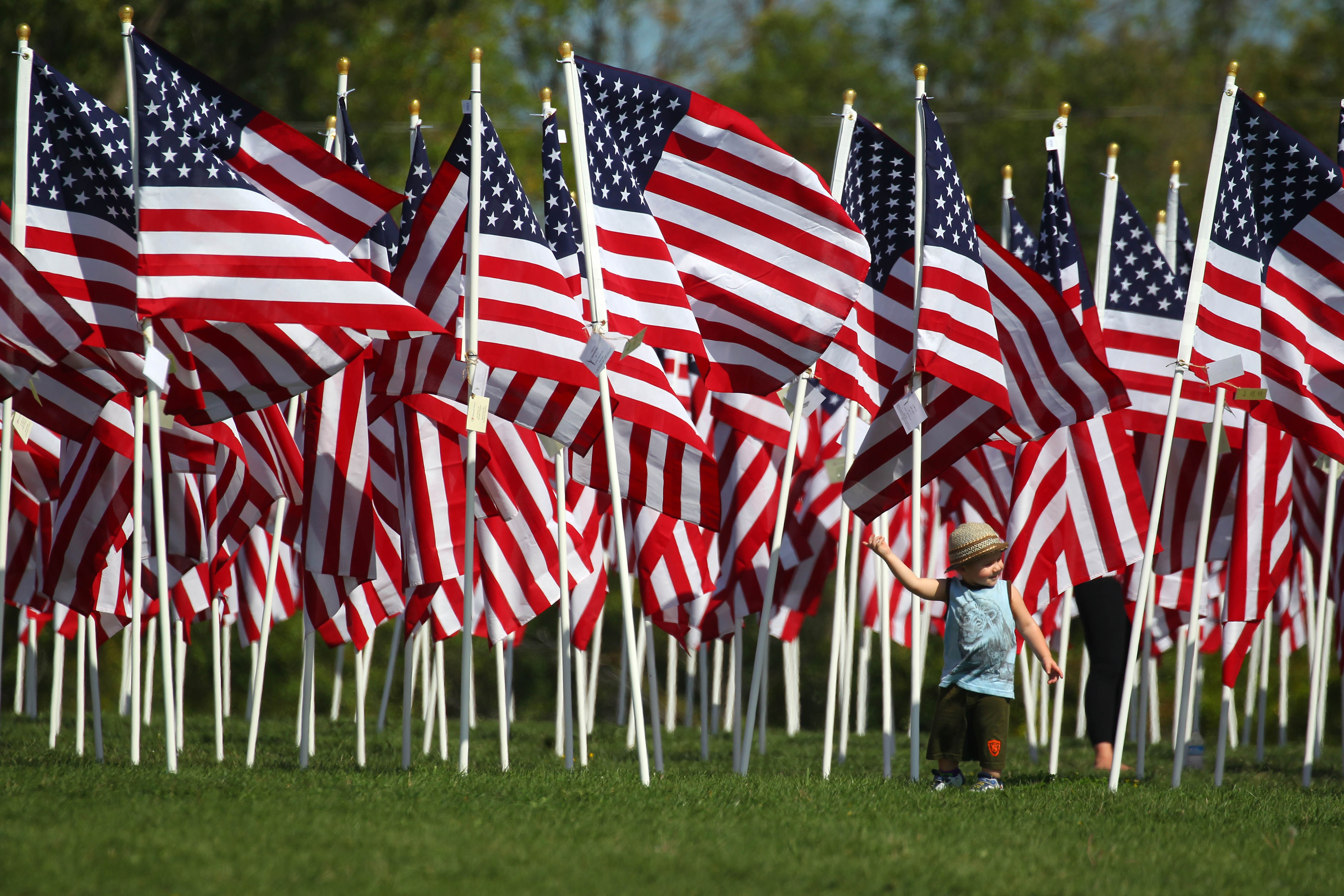 Little Gavin Bird walks with his grandmother Suzy Bird through 3000 American flags this weekend as a memorial to victims and first responders of 911 at Gratwick Park in North Tonawanda. The memorial was organized by Exchange Club members.   TTTonawanda Exchange.     (Mark Mulville/Buffalo News)