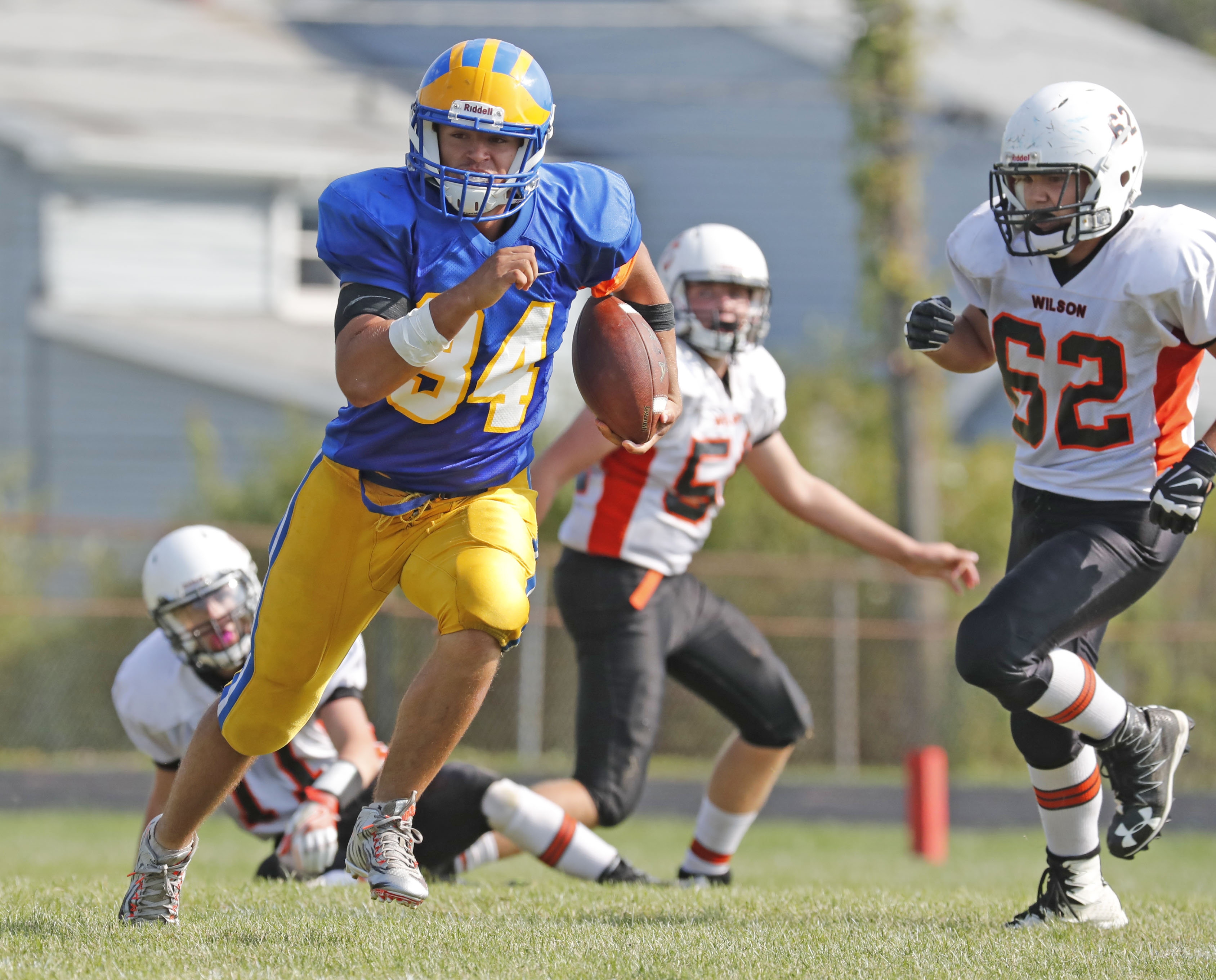 Cleveland Hill's Ryan Majerowski runs for a second half touchdown against Wilson during Saturday's game in Cheektowaga.