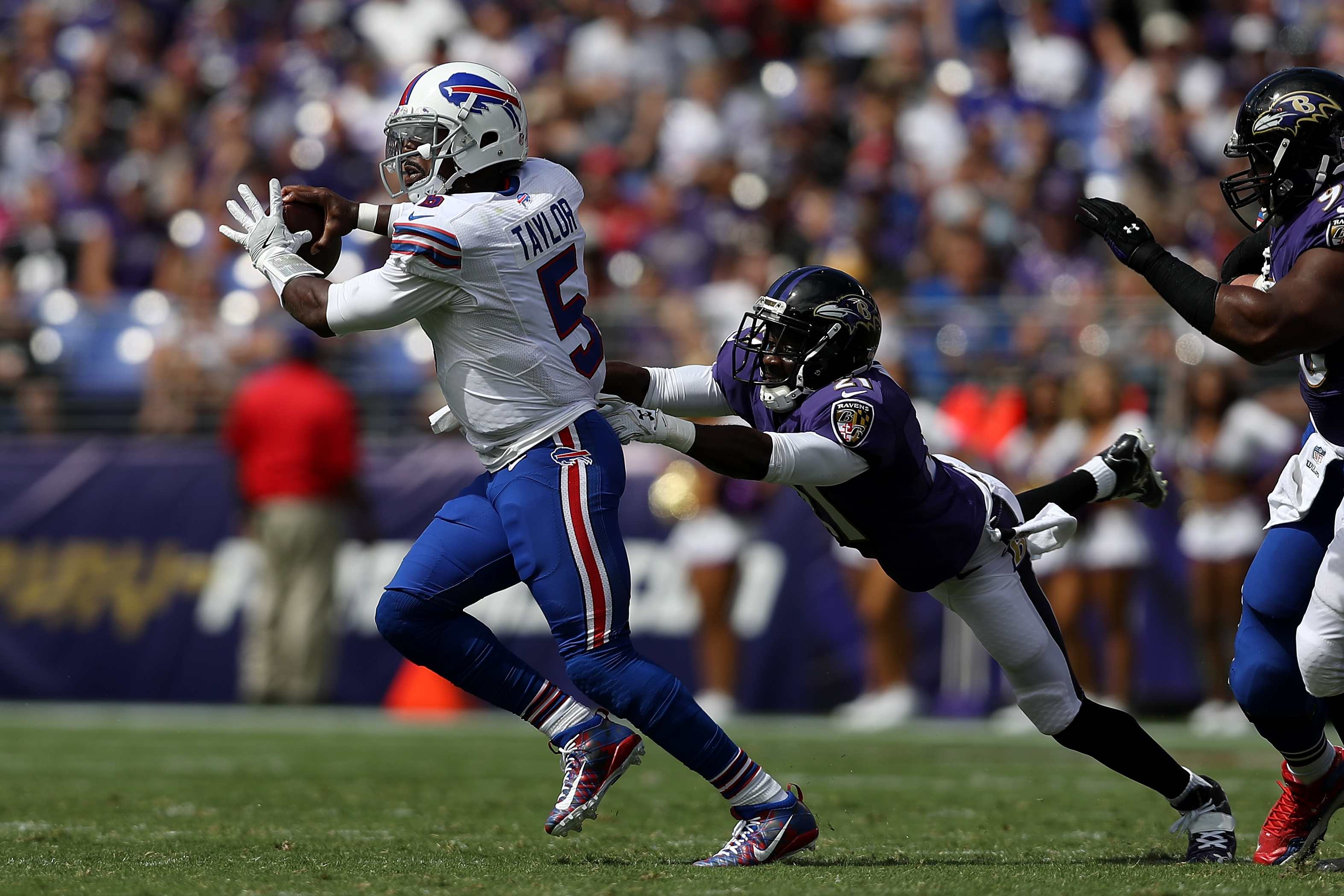 Tyrod Taylor attempts to throw the ball as he is tackled by cornerback Lardarius Webb.