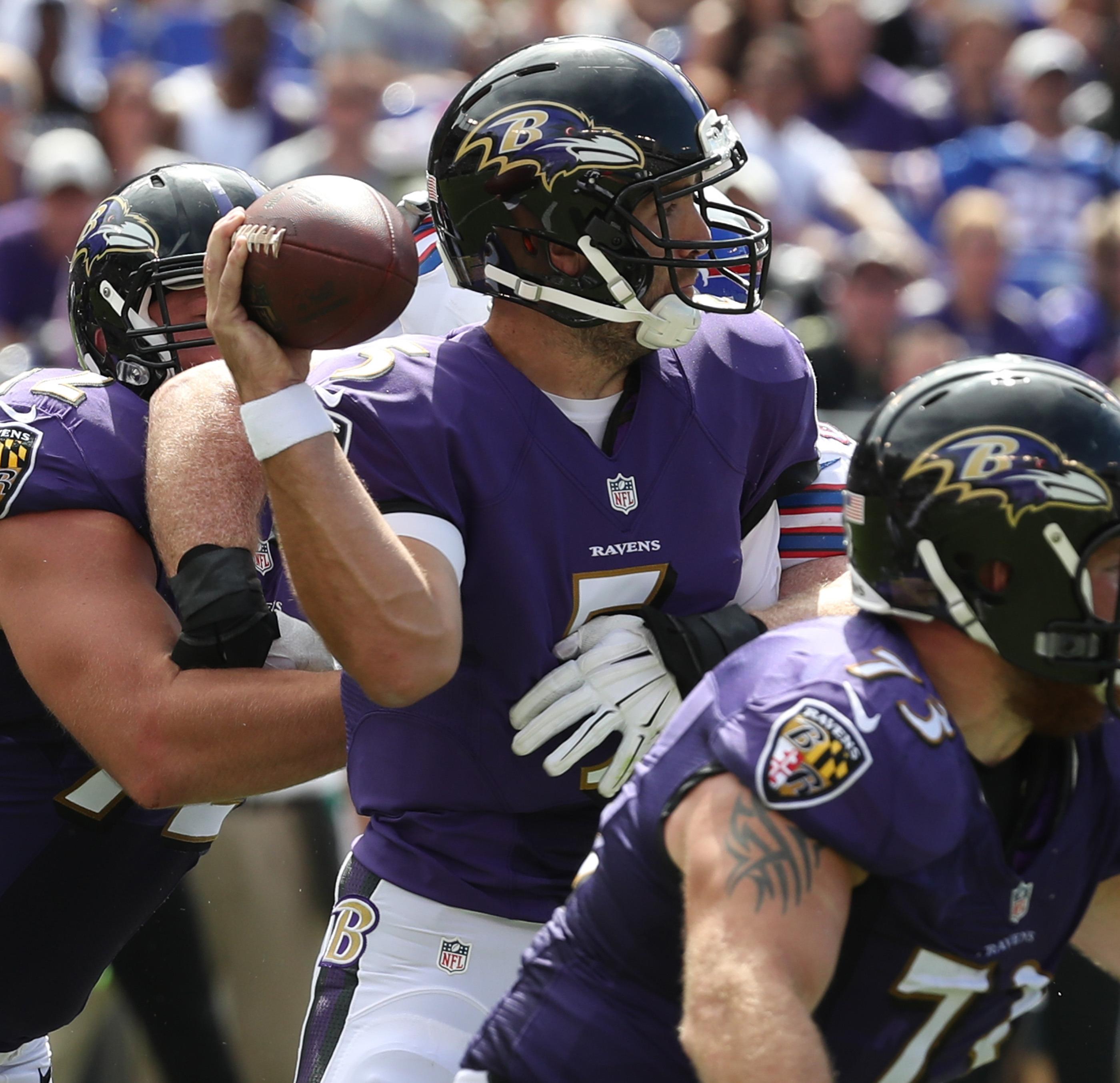 Baltimore Ravens quarterback Joe Flacco is sacked in the second quarter.