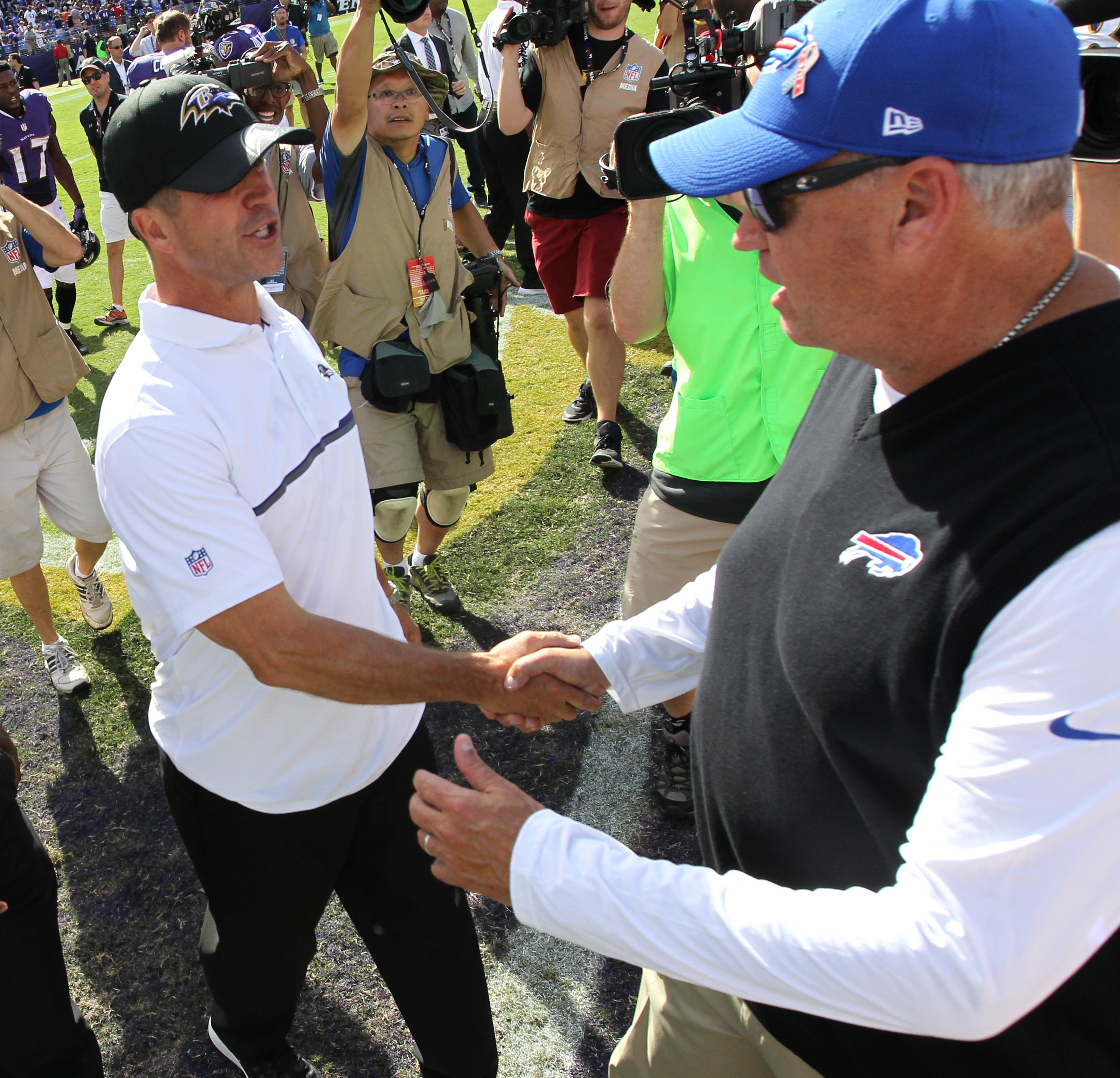 Buffalo Bills head coach Rex Ryan and Baltimore Ravens head coach John Harbaugh shake hands at the end of the game. They got very different grades in our report card.