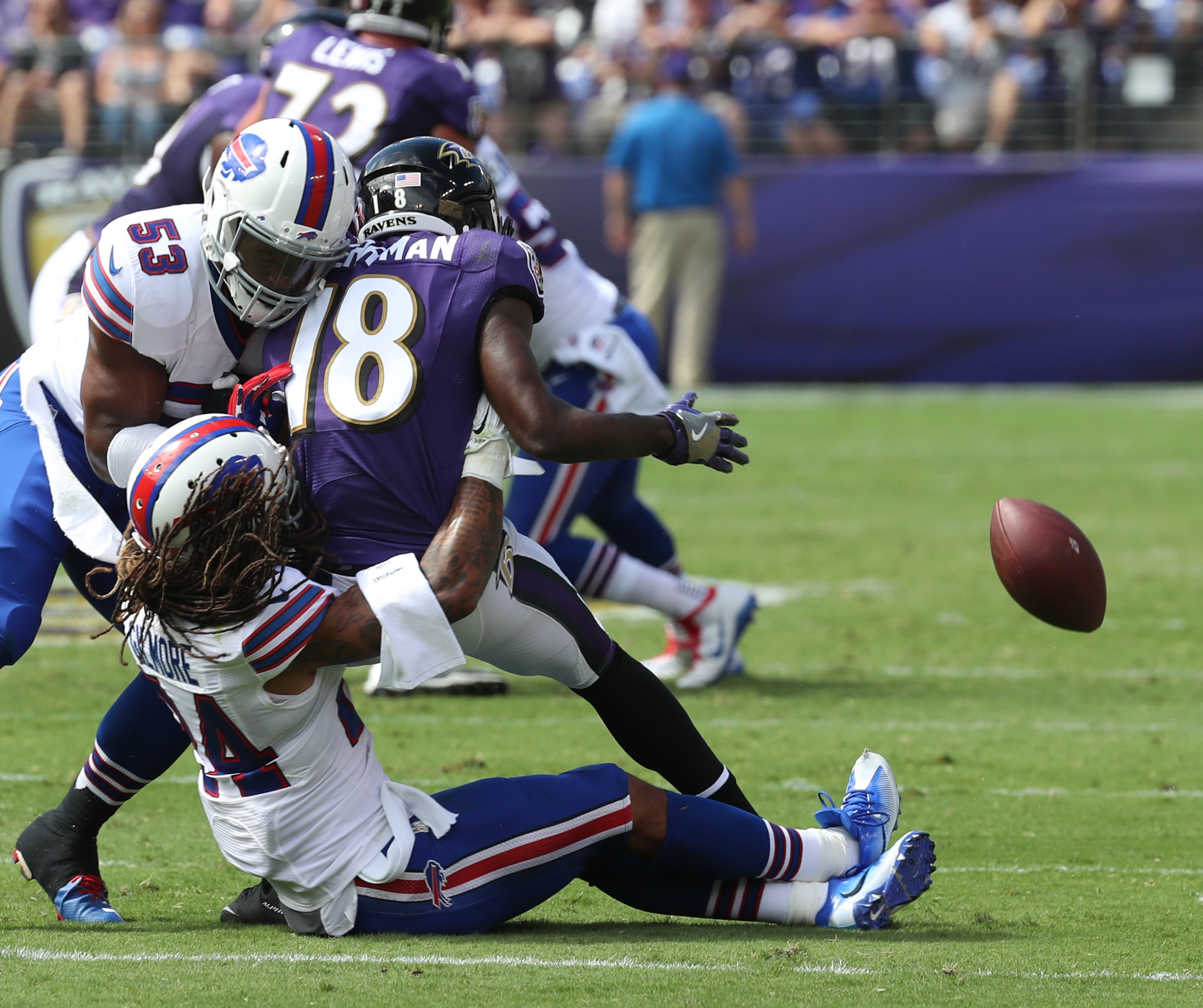 Stephon Gilmore (24) breaks up a pass intended for Ravens wide receiver Breshad Perriman.