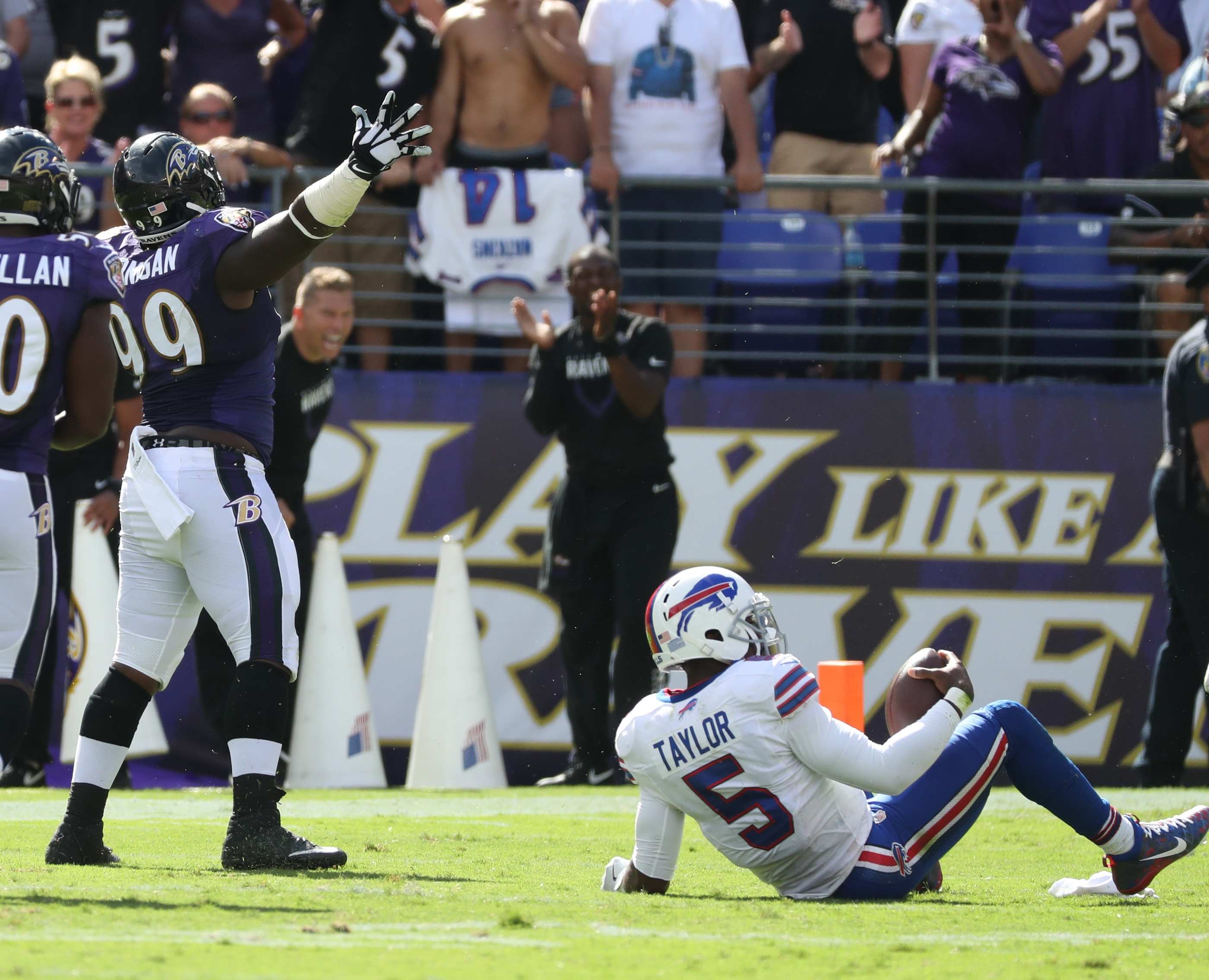 Buffalo Bills quarterback Tyrod Taylor (5) is sacked by Baltimore Ravens defensive end Timmy Jernigan (99) in the fourth quarter at M&T Bank Stadium in Baltimore,MD on Sunday, Sept. 11, 2016.  (James P. McCoy/ Buffalo News)