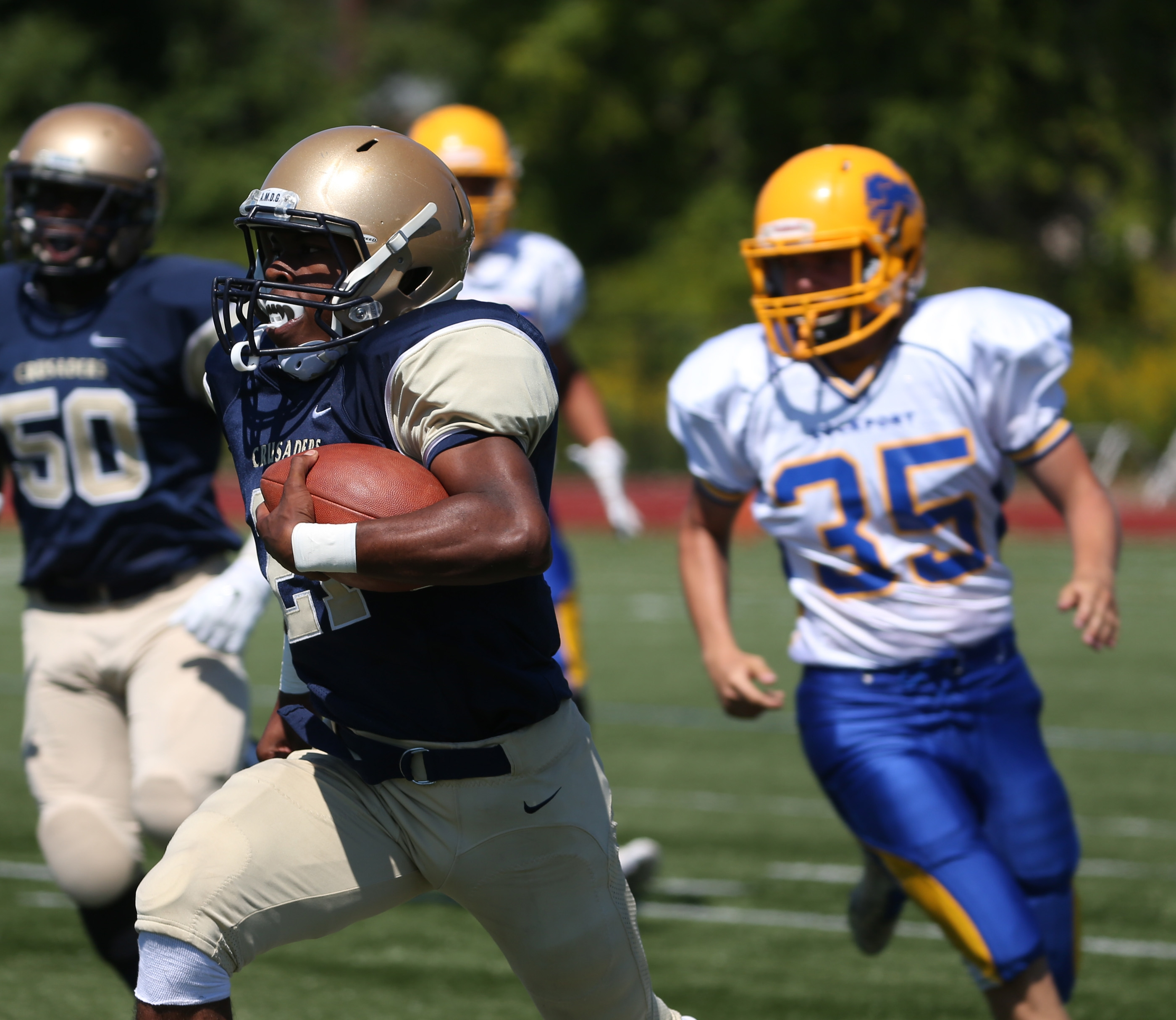 Canisius' Kenyatta Huston, shown carrying the ball against Lockport, and the rest of the Crusaders are again ranked No. 1 among large schools this week.