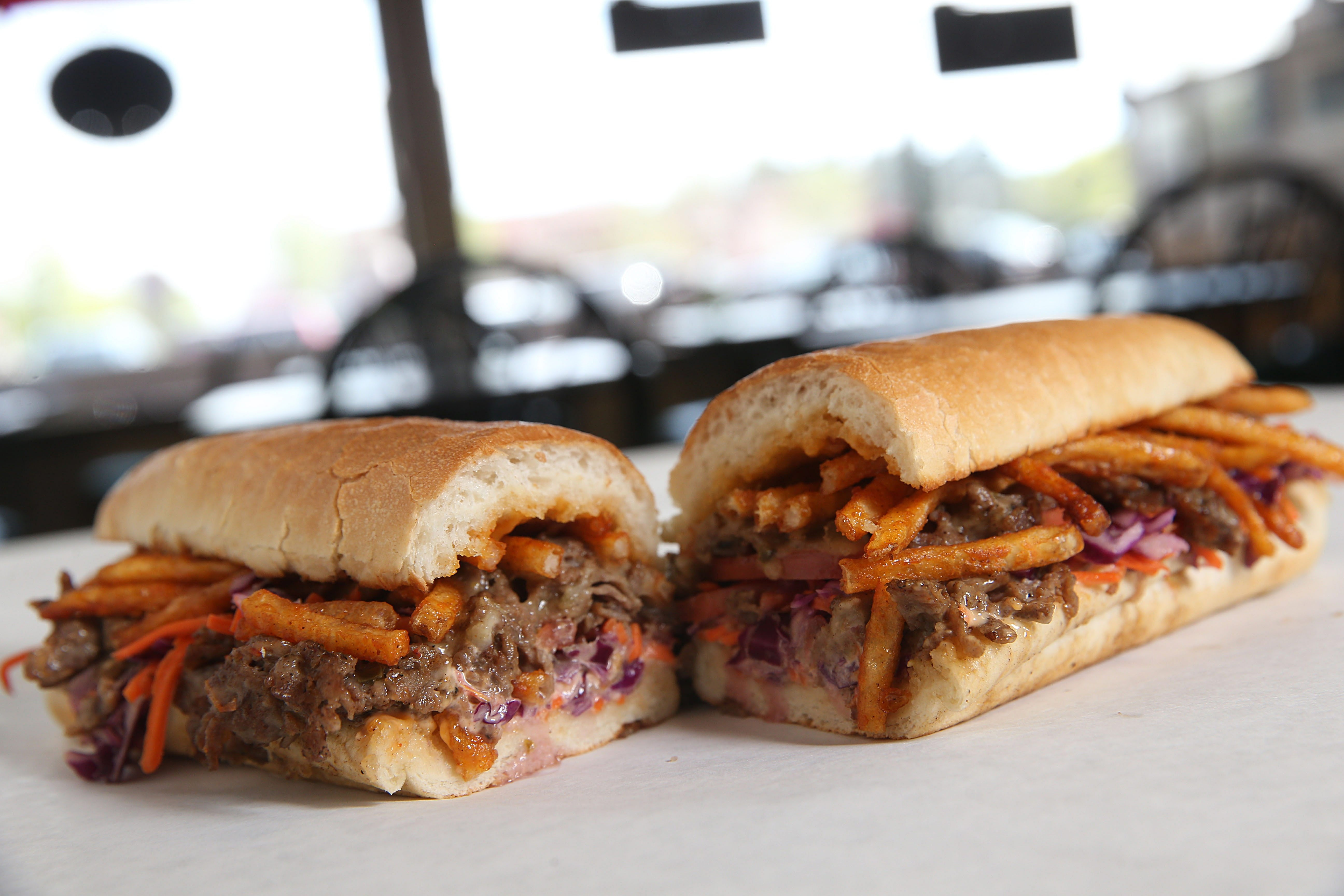The Spicy Dragon at Jonny C's features chopped steak, melted cheese, seasoned french fries, sweet chili coleslaw, Sriracha mayo and tomato all on a toasted roll.