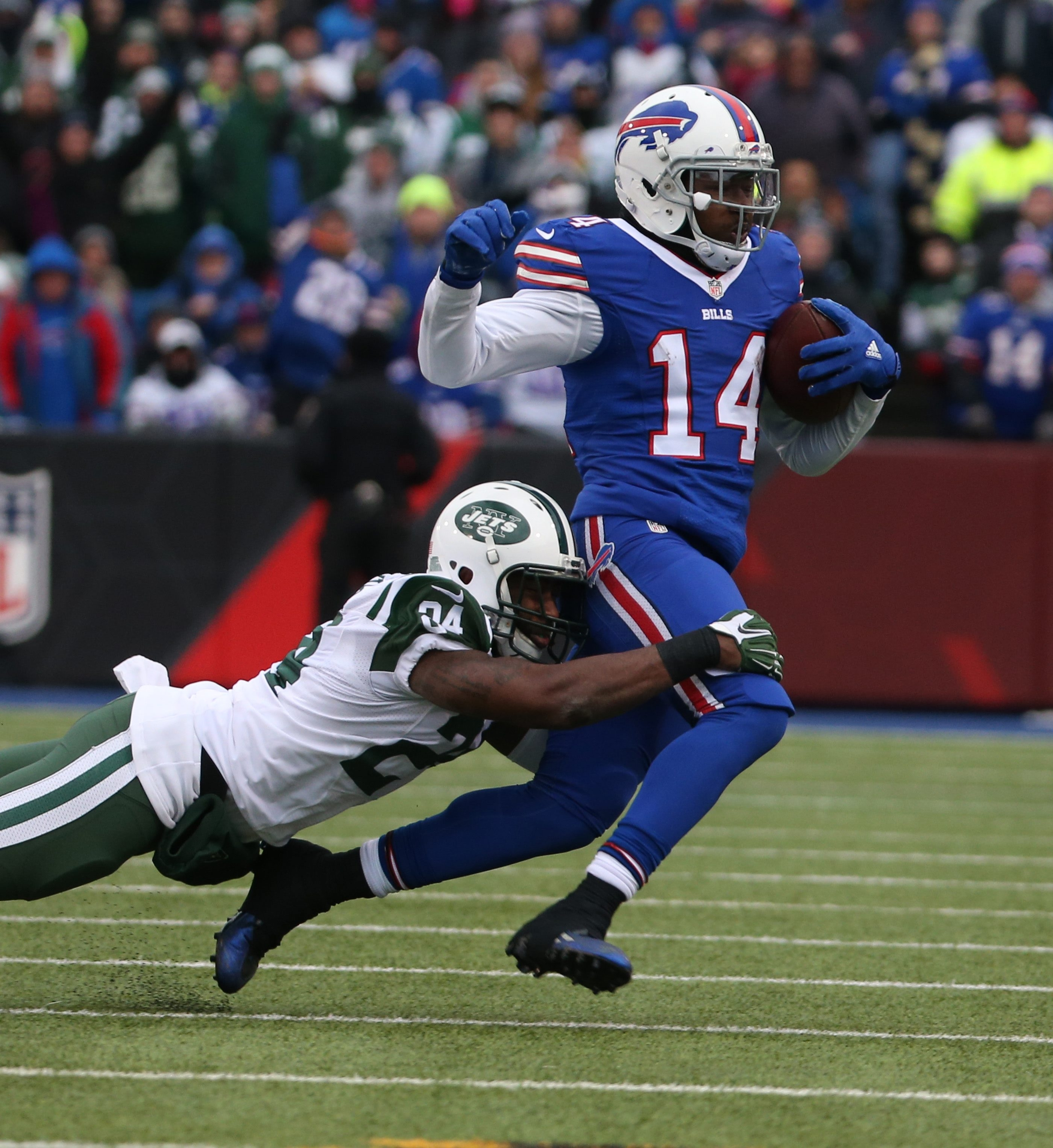 Buffalo Bills wide receiver Sammy Watkins (14) caches a pass for a first down in front of New York Jets cornerback Darrelle Revis (24) in the third quarter on Sunday, Jan. 3, 2016.