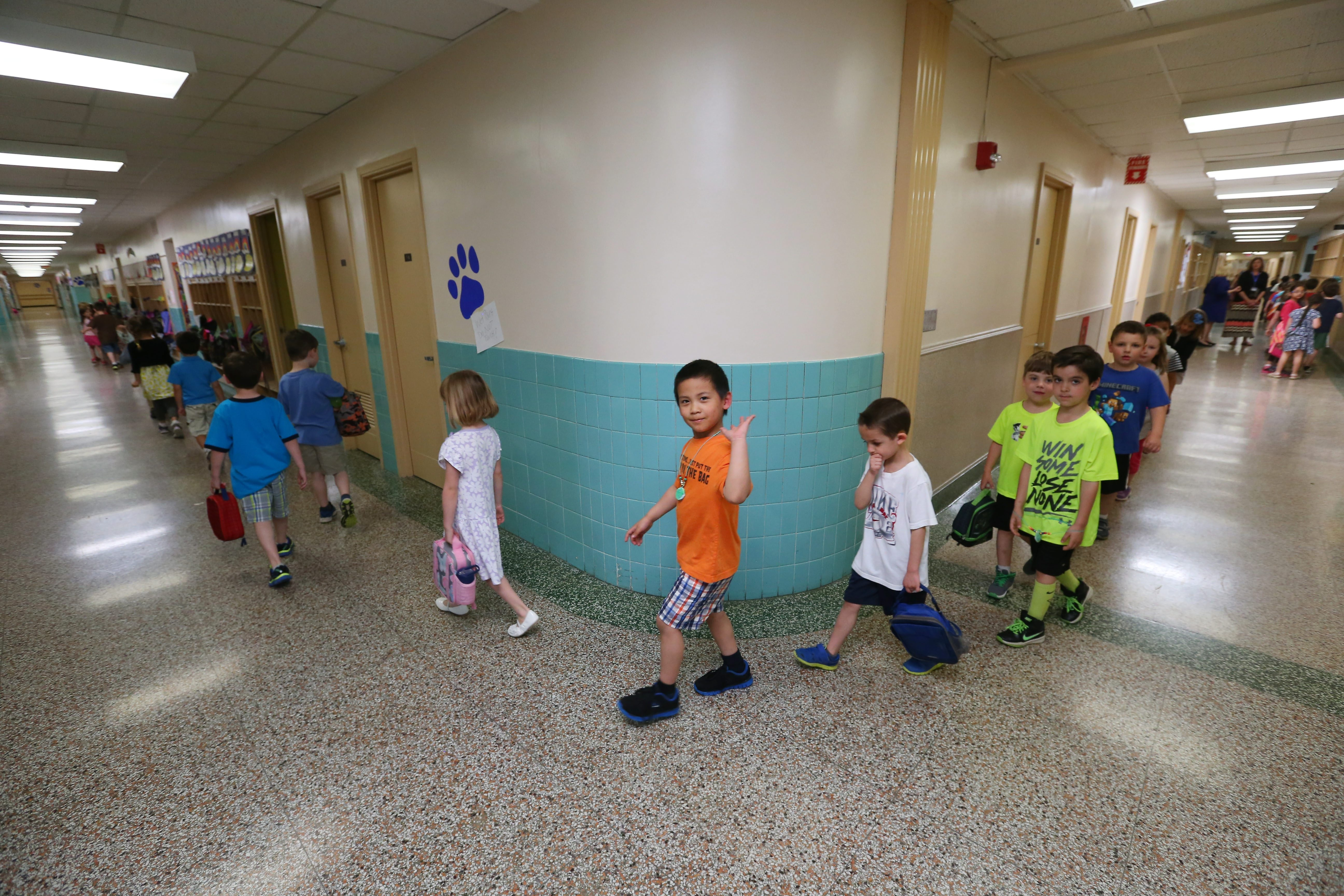 Children in kindergarten through fourth grade in the Williamsville Schools will now have 20-minute recess every day.  (Buffalo News file photo of kindergarteners at Maple East)