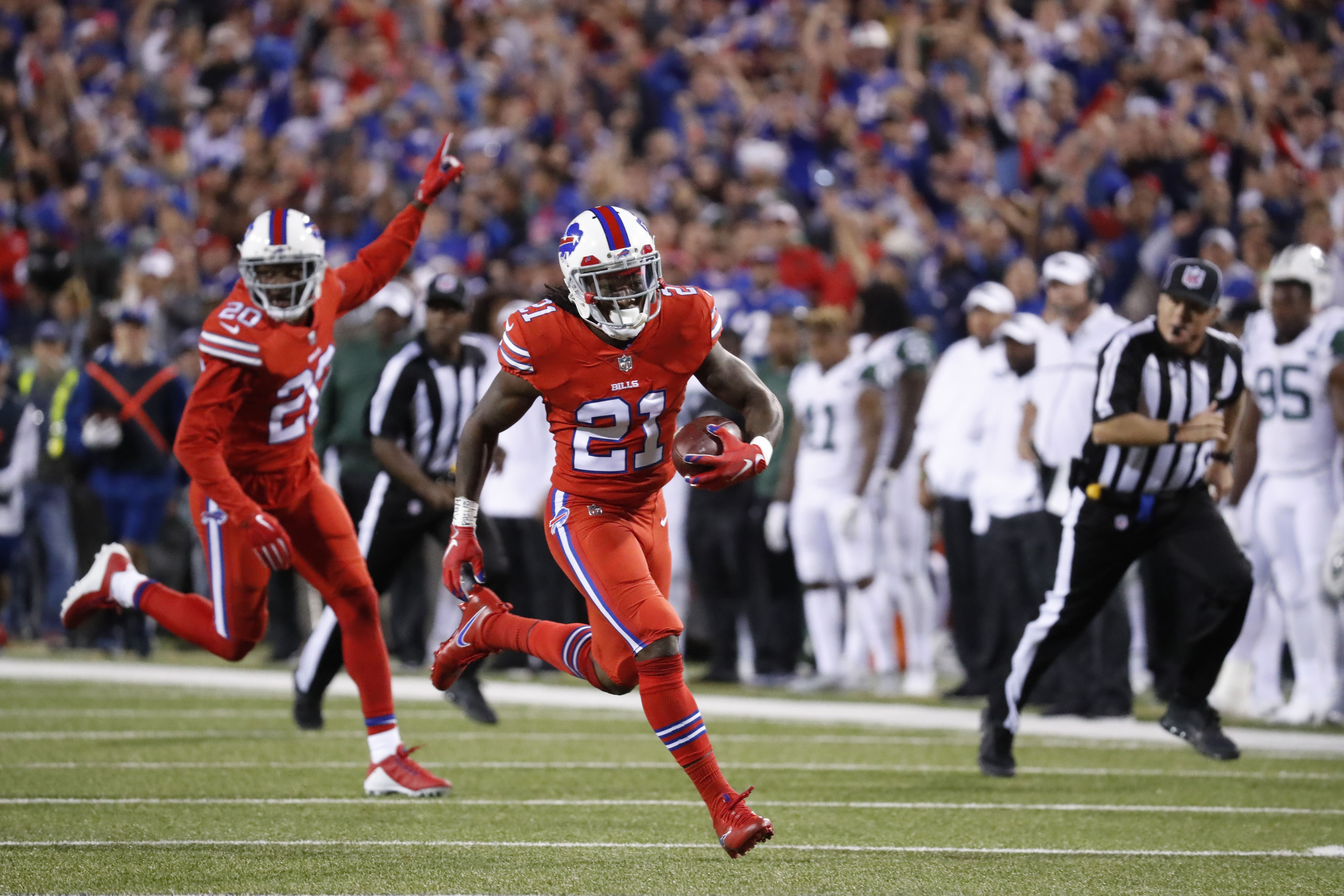 Buffalo Bills cornerback Nickell Robey-Coleman (21) returns a fumble for a touchdown.