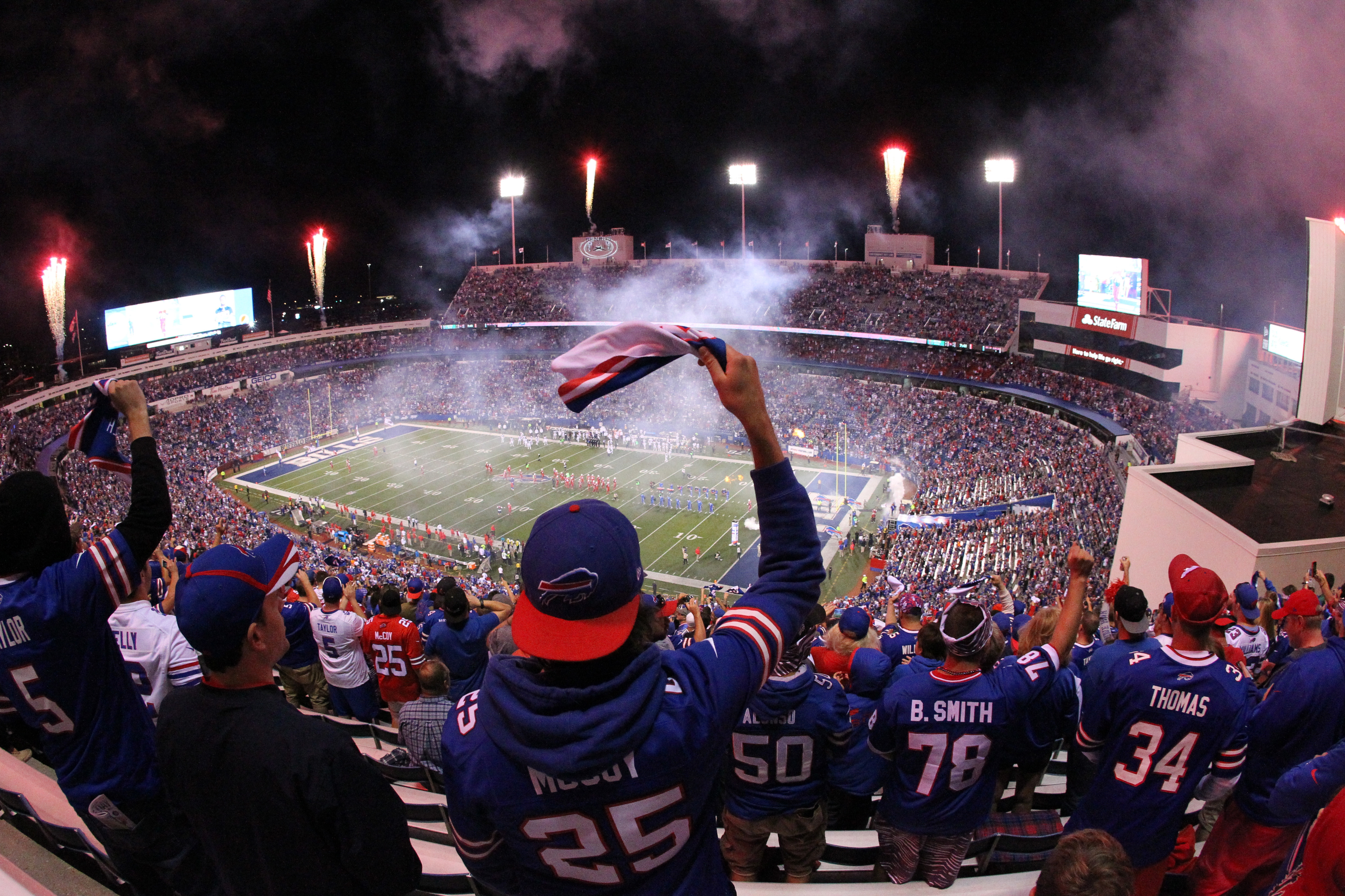 Bills fans cheer as their team takes the field for the Jets game at New Era Field.