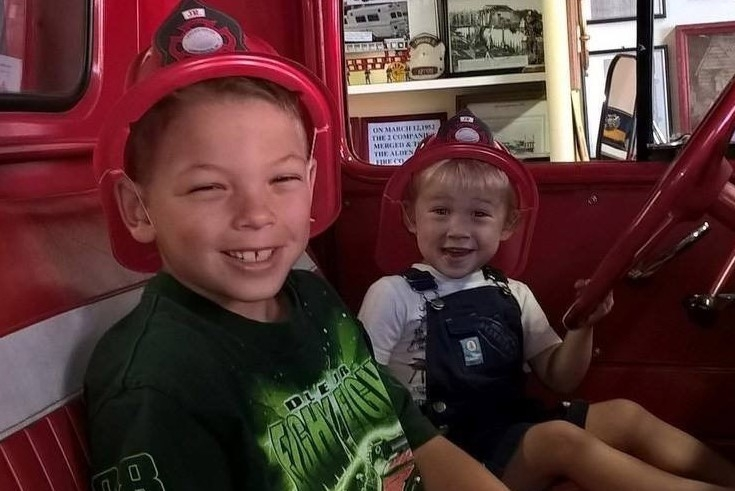 Leo Klinger, 7, who was killed Thursday along with his mother, Raina Voll, is shown in a family photo with his brother, 2-year-old Stephen.