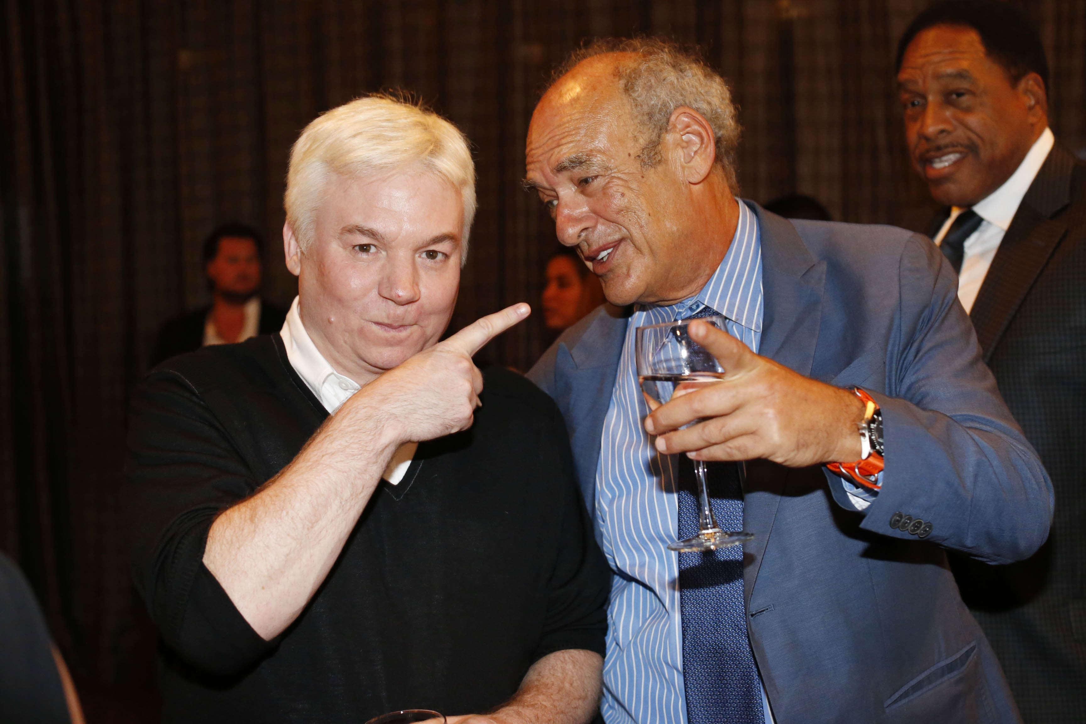 Legendary producer Shep Gordon, right, chats with actor Mike Myers during a fundraiser he cohosted to start a scholarship to the Culinary Institute of America in honor of his late friend, legendary chef Roger Verge, at the Lighthouse at Chelsea Piers in New York City, Monday, Sept. 12, 2016.  Myers produced a documentary about Gordon titled 'Supermensch.'  (Derek Gee/Buffalo News)