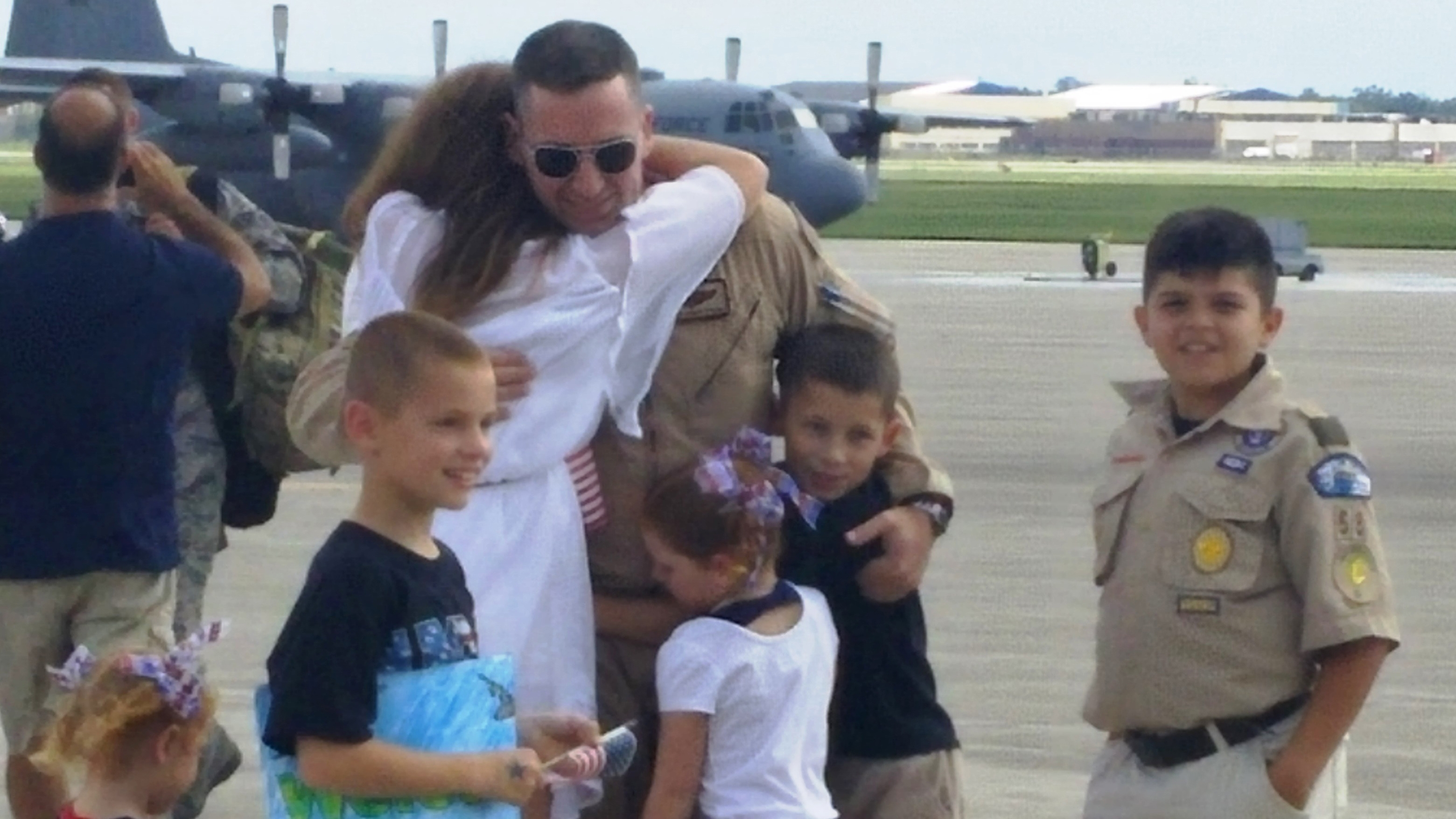 Major Rick Konopczynski, a C-130 pilot, greets his wife, Jessica, their six children, and his Pendleton cub scout pack at a homecoming Sunday at the Niagara Falls Air Reserve Base. (Nancy Fischer/Buffalo News)