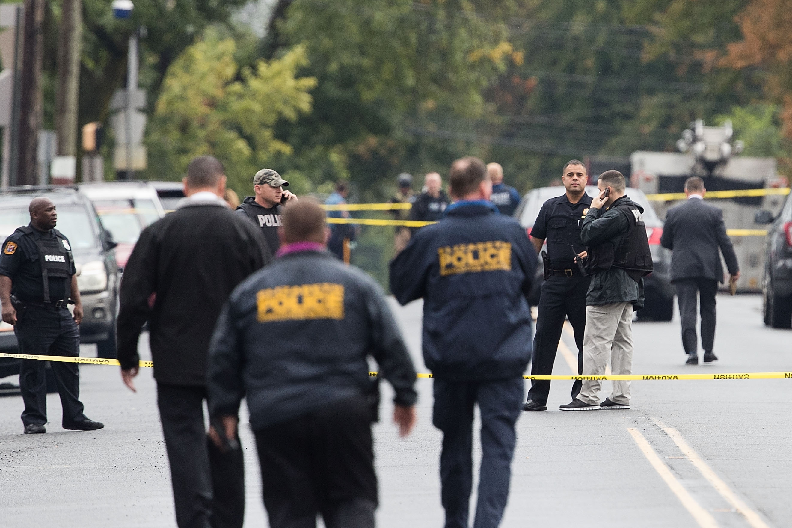 Law enforcement officers flood the neighborhood in Linden, N.J., where bombing suspect Ahmad Khan Rahami was arrested.