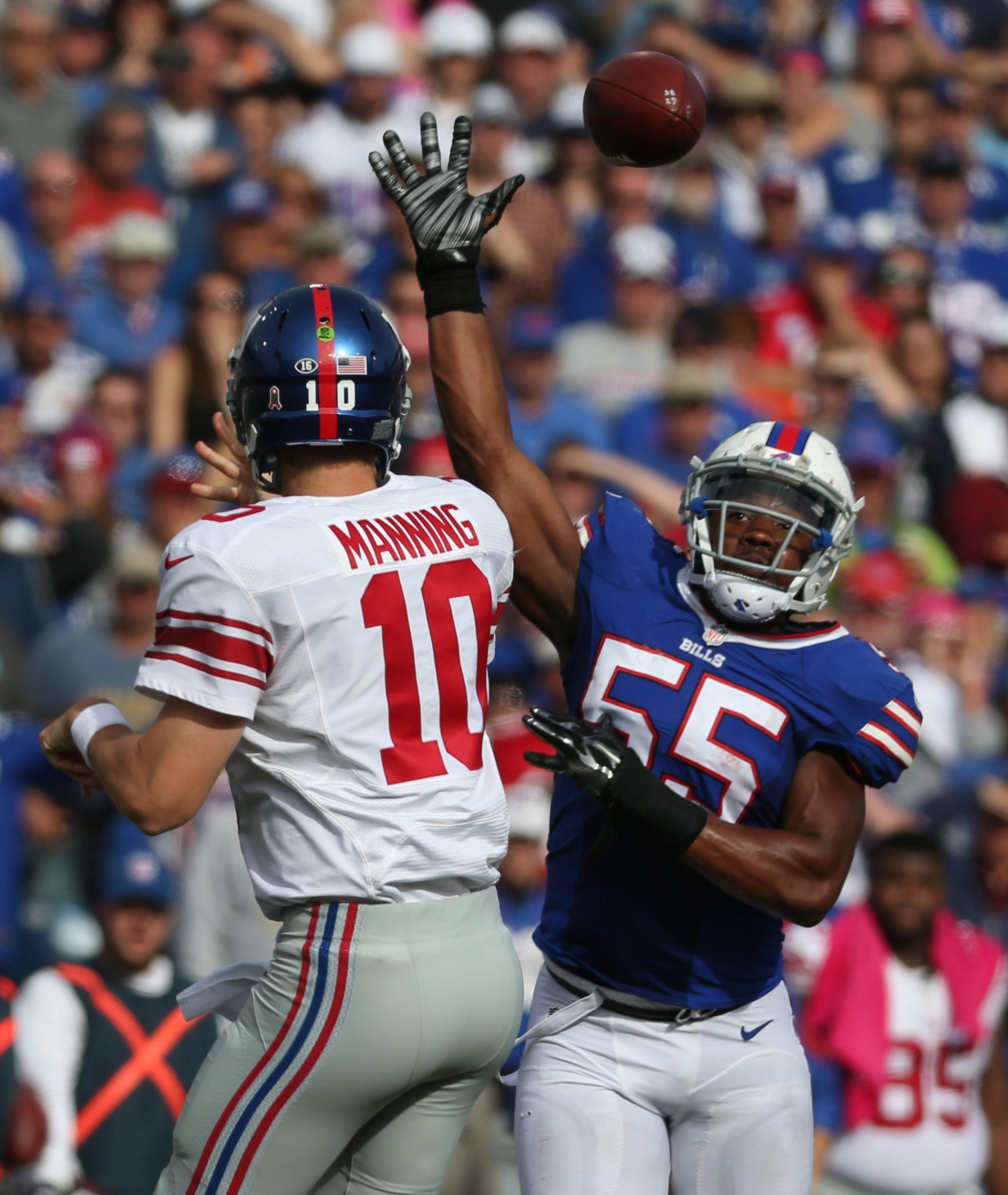 Buffalo Bills outside linebacker Jerry Hughes (55) pressures New York Giants quarterback Eli Manning. (James P. McCoy/Buffalo News)