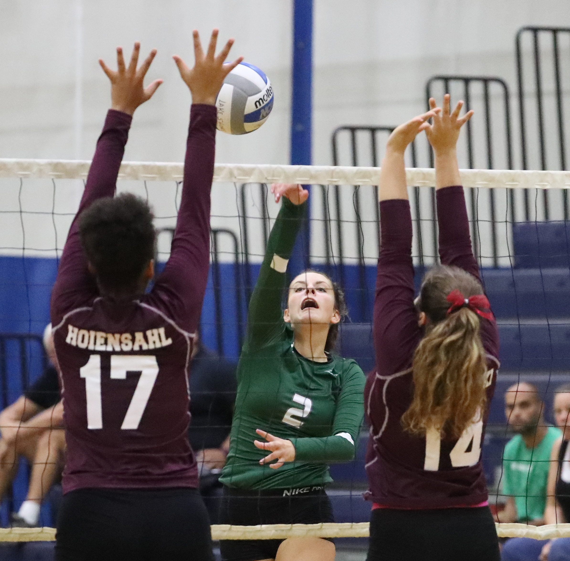 Lake Shore's Talia Wright spikes the ball against Maryvale's Alexa Hoiensahl and Emily Raczynski in their volleyball match Tuesday.