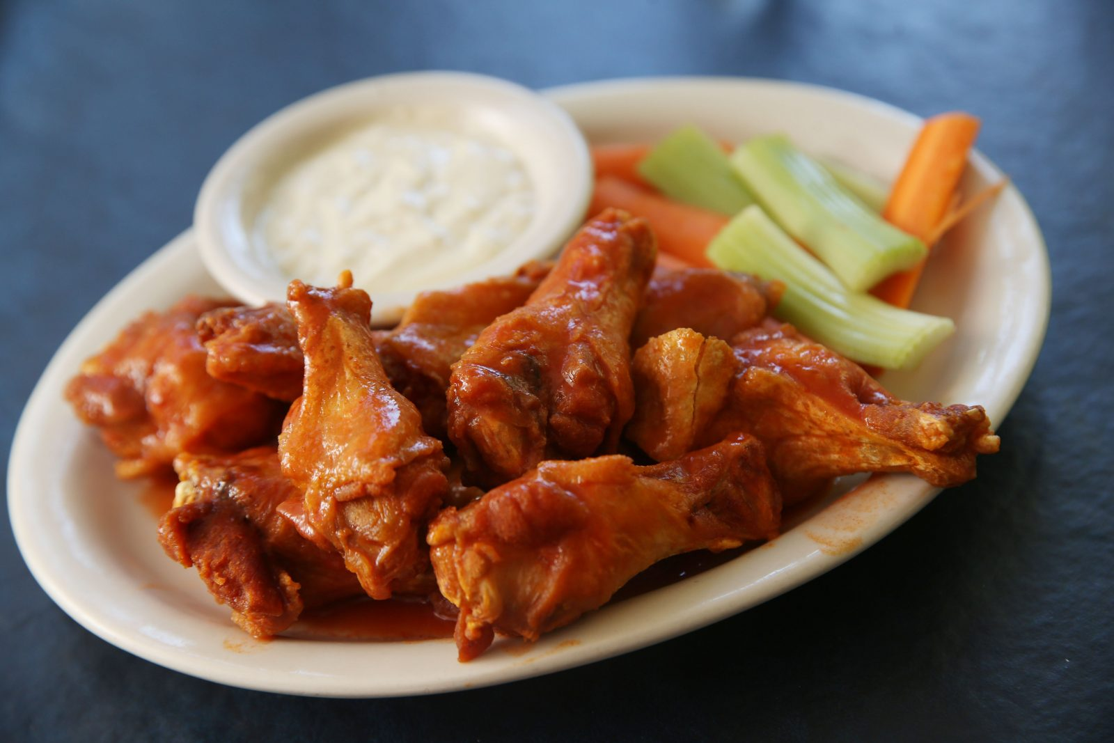 The Village Inn is at 1488 Ferry Road on Grand Island. The jumbo chicken wings are served with bleu cheese dressing, celery and carrots. (Sharon Cantillon/Buffalo News)