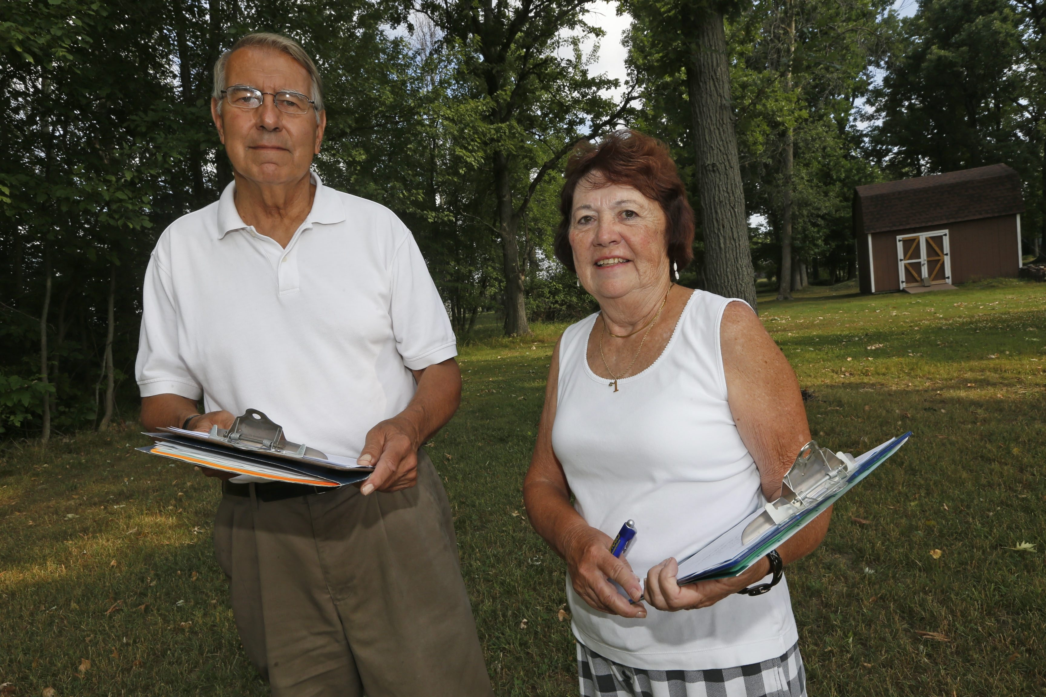 Joan Priebe and Irvine. G. Reinig II collect signatures on a petition to dissolve the Village of Depew on Friday, July 15, 2016. (Robert Kirkham/Buffalo News)