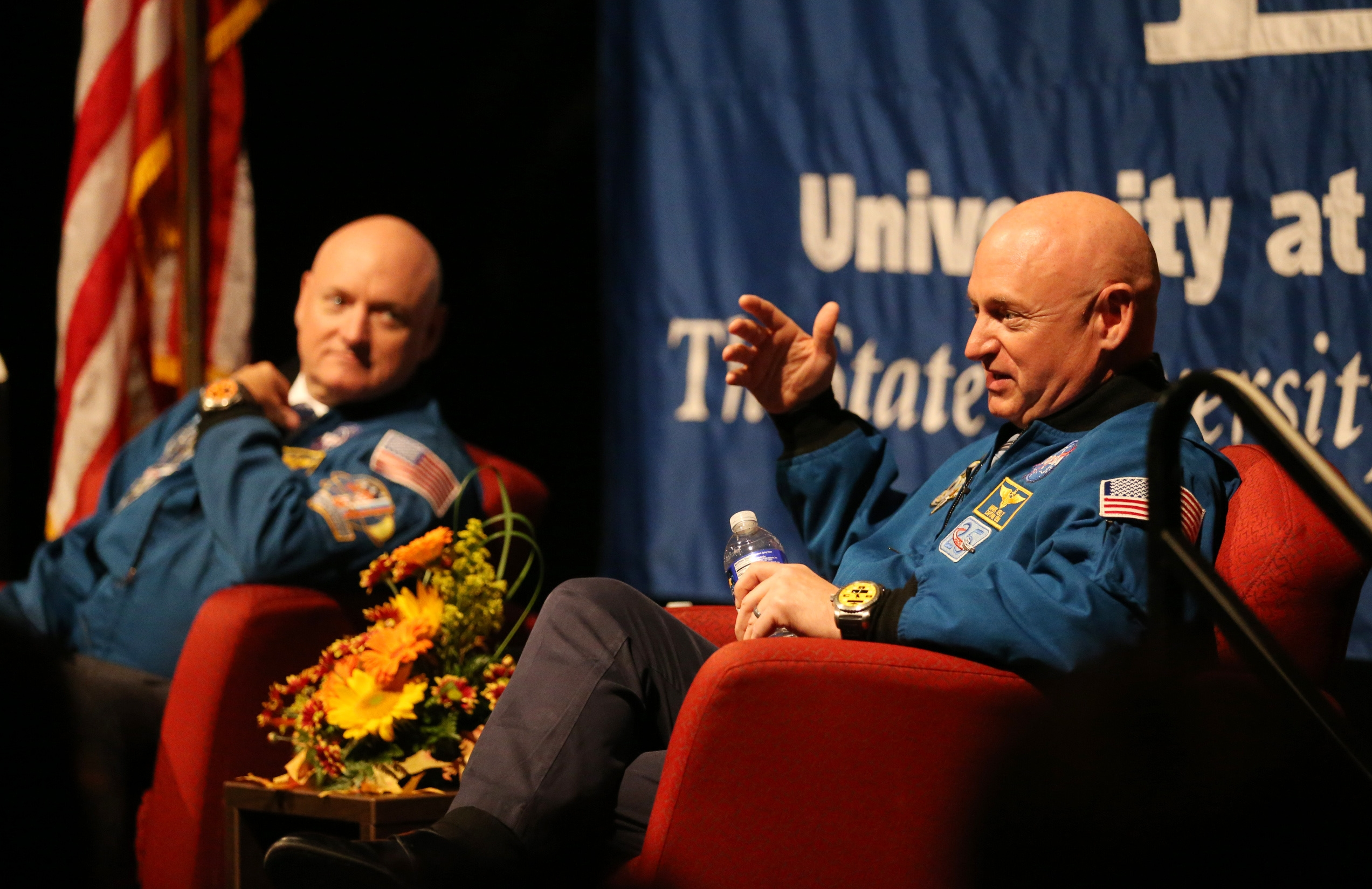 Twin astronauts Scott, left, and Mark Kelly, speaking Thursday after- noon at the University at Buffalo, were the subject of a NASA experiment to test the effects of long-term space travel on humans. Scott spent 340 days in space, while Mark stayed on Earth as the control subject.