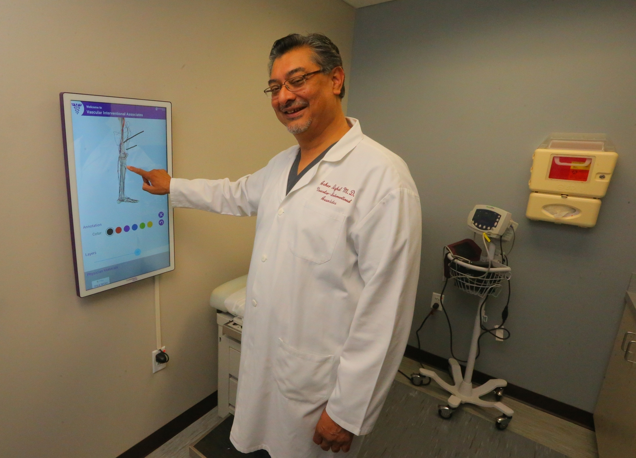 """It used to be that with other methods, treatment of ulcers might last months, maybe even years. This way, patients can get better in a matter of a few weeks, depending on the severity of their wound."" Dr. Azher Iqbal, demonstarting a touch-screen ""anatomy board."""