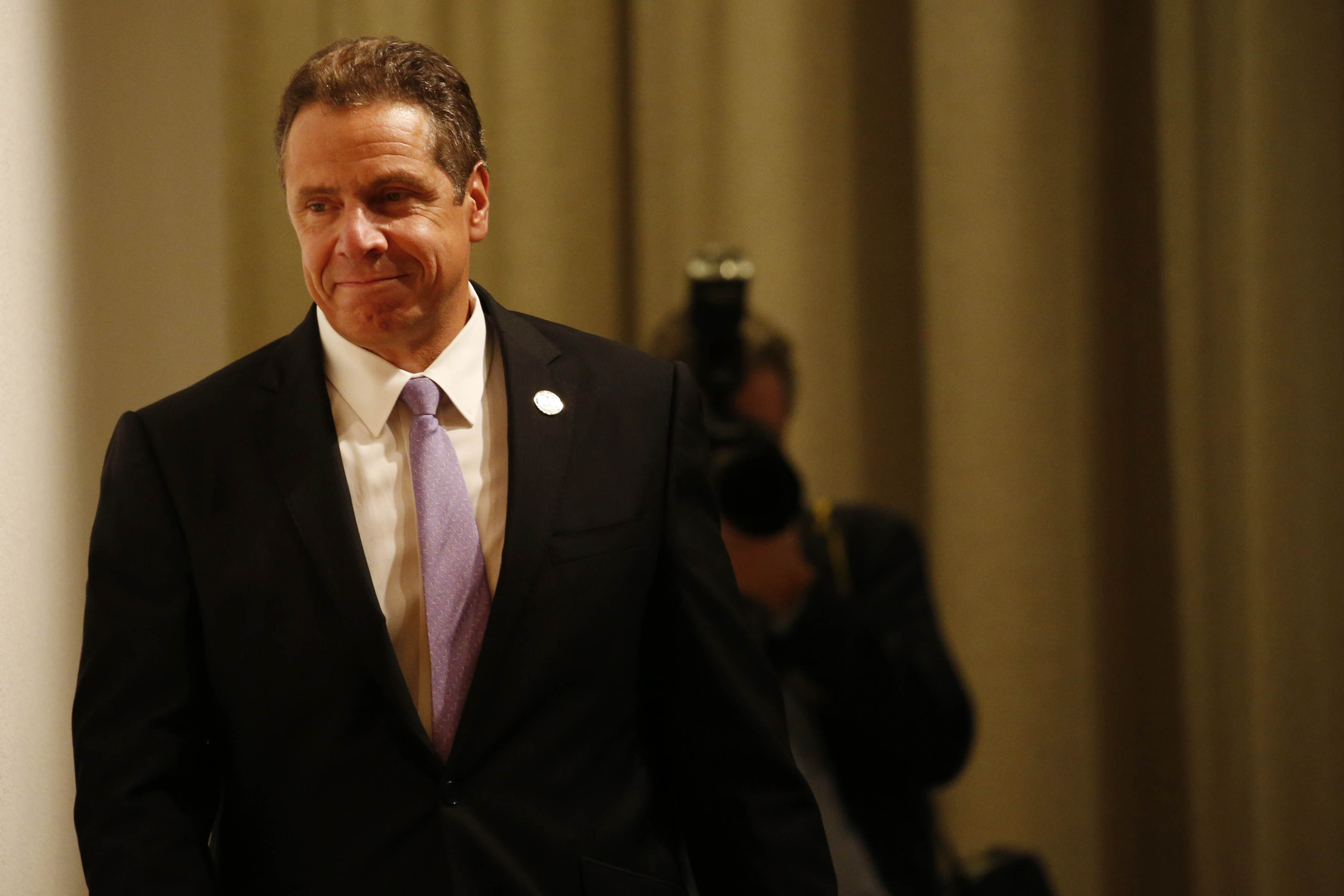Gov. Andrew Cuomo takes the stage to speak at the Albright-Knox Art Gallery on Friday.