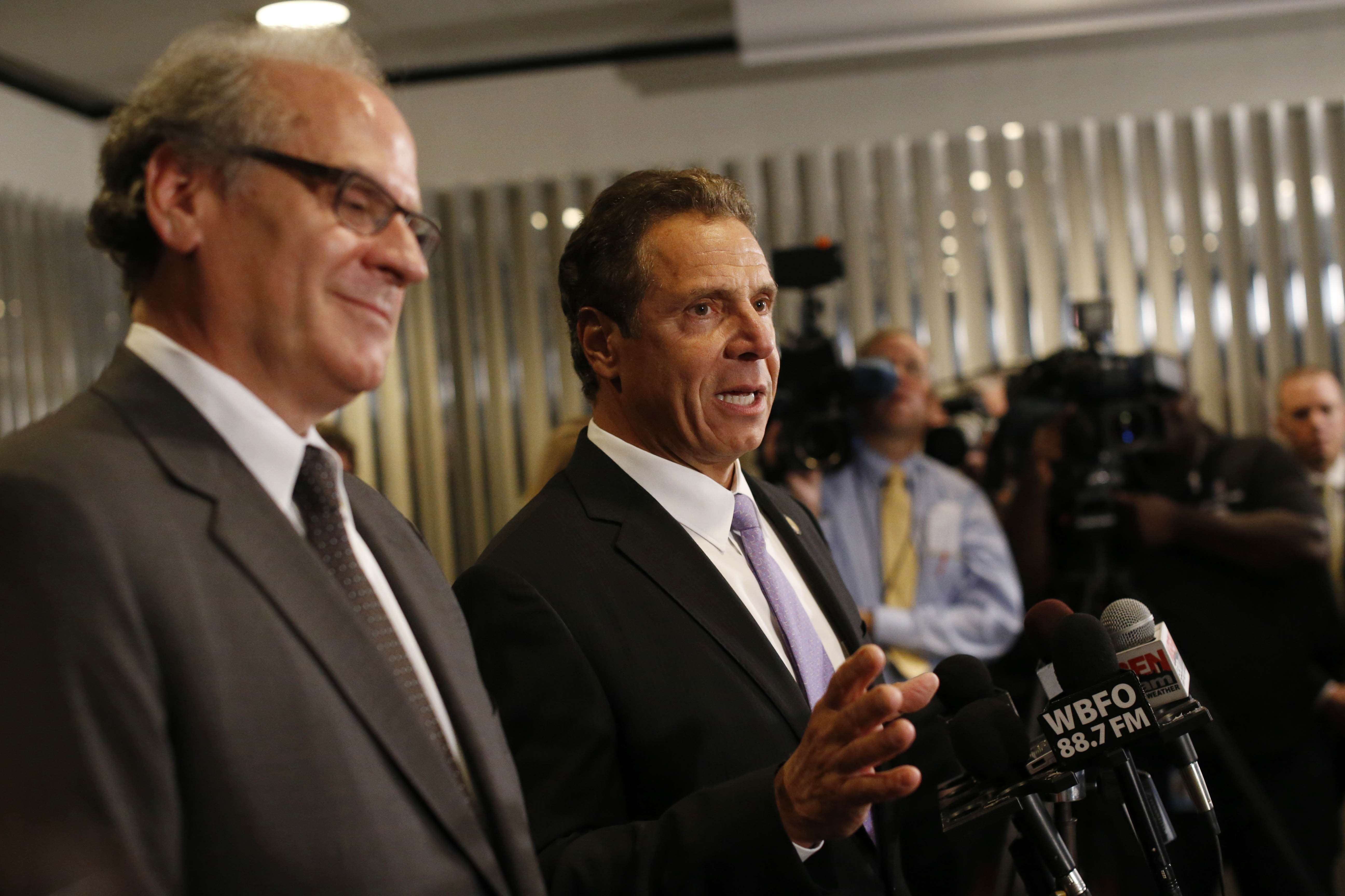 Gov. Andrew Cuomo speaks during a gaggle with reporters following an event at the Albright-Knox Art Gallery on Friday, Sept. 23, 2016. Looking on is Empire State Development CEO Howard Zemsky. (Derek Gee/Buffalo News)