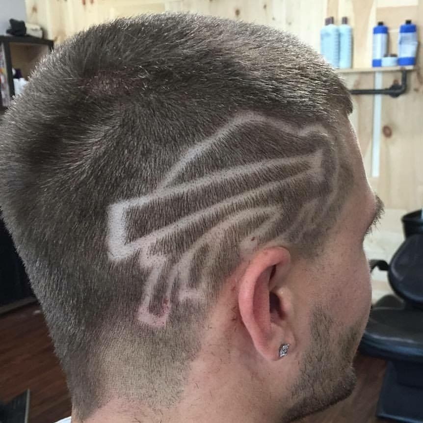 A Bills fan sports the team's logo shaved into his hair. New Era Cap Co. contracted with Rust Belt Barbering to shave heads before Sunday's game.