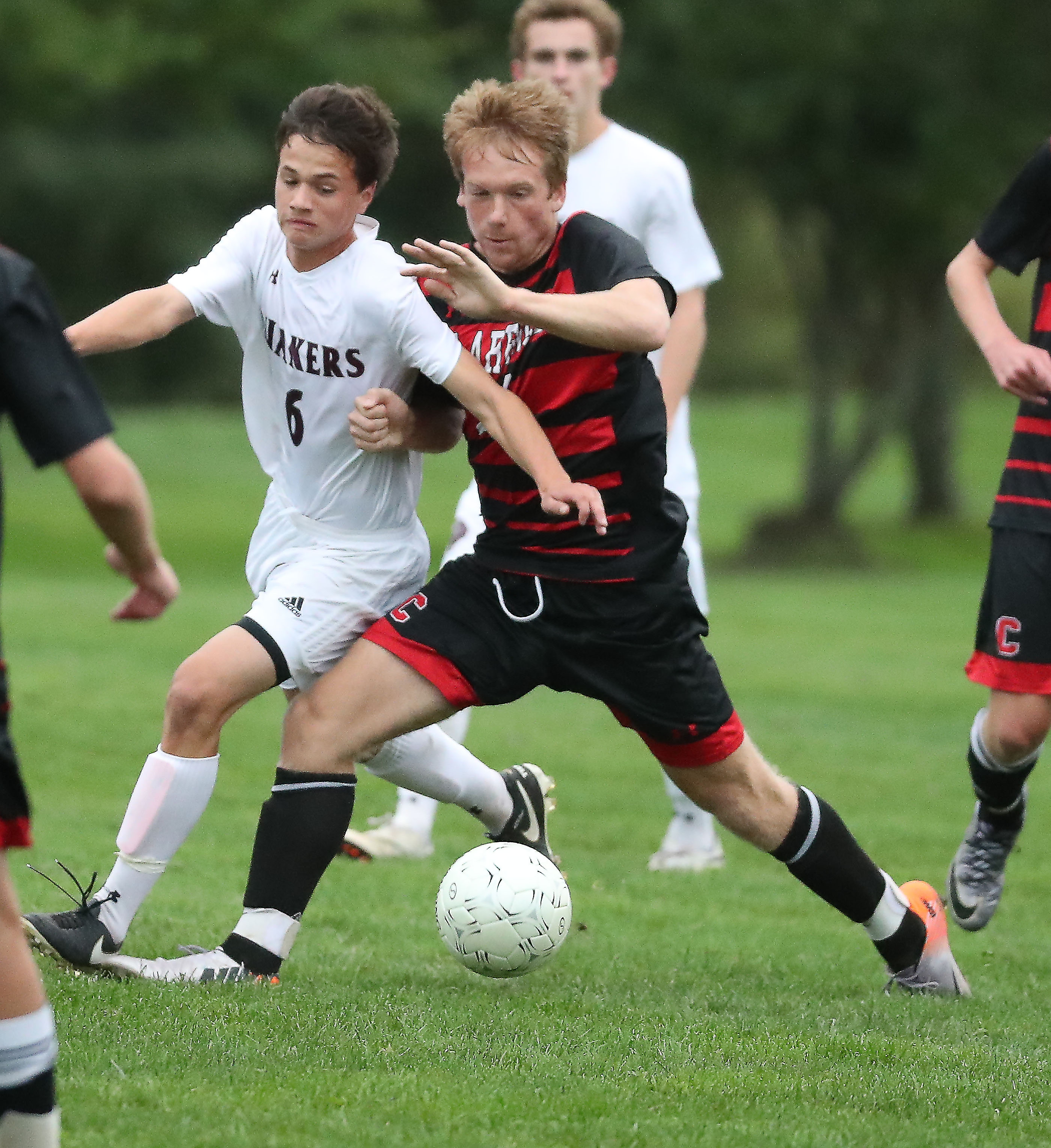 Clarence's Nick Lunetta tries to get position on Orchard Park's Jonathan Pardi in the first half of their game on Friday. The Red Devils never trailed in their win.