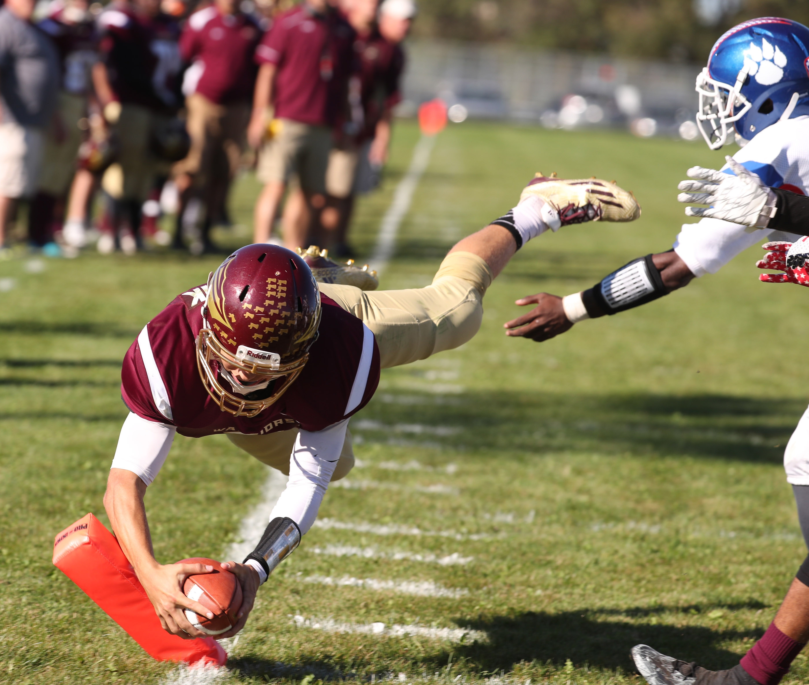 Cheektowaga quarterback Eric Bartnik dives into the end zone for a two-point conversion in the third quarter against Burgard Saturday. Bartnik threw for 170 yards and ran for 117.