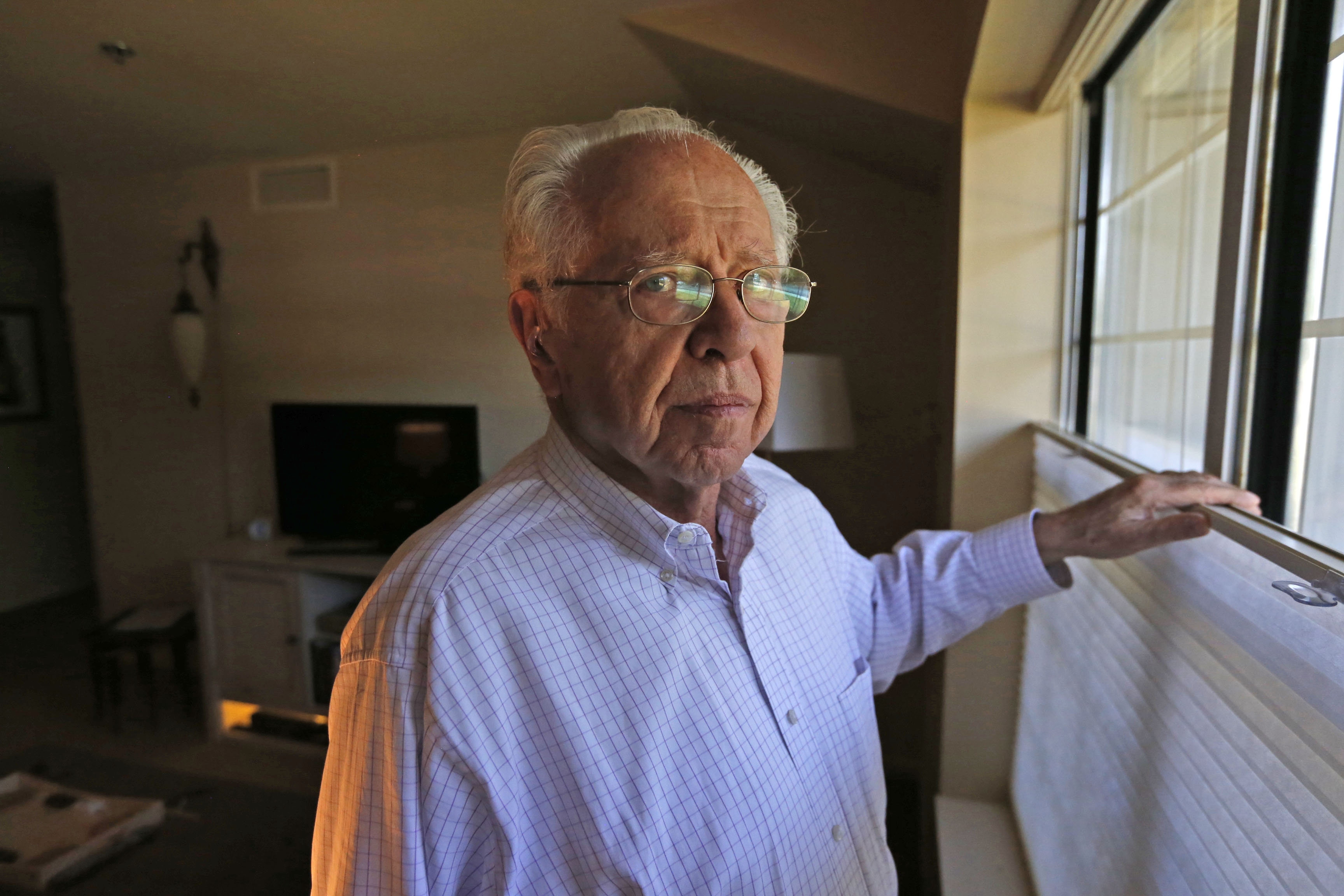 Stephan H. Lewy, in his apartment in Amherst, now has the time to reflect on the horrors that his family and thousands of other Jews suffered under the Nazis' oppression during the Holocaust. (Robert Kirkham/Buffalo News)