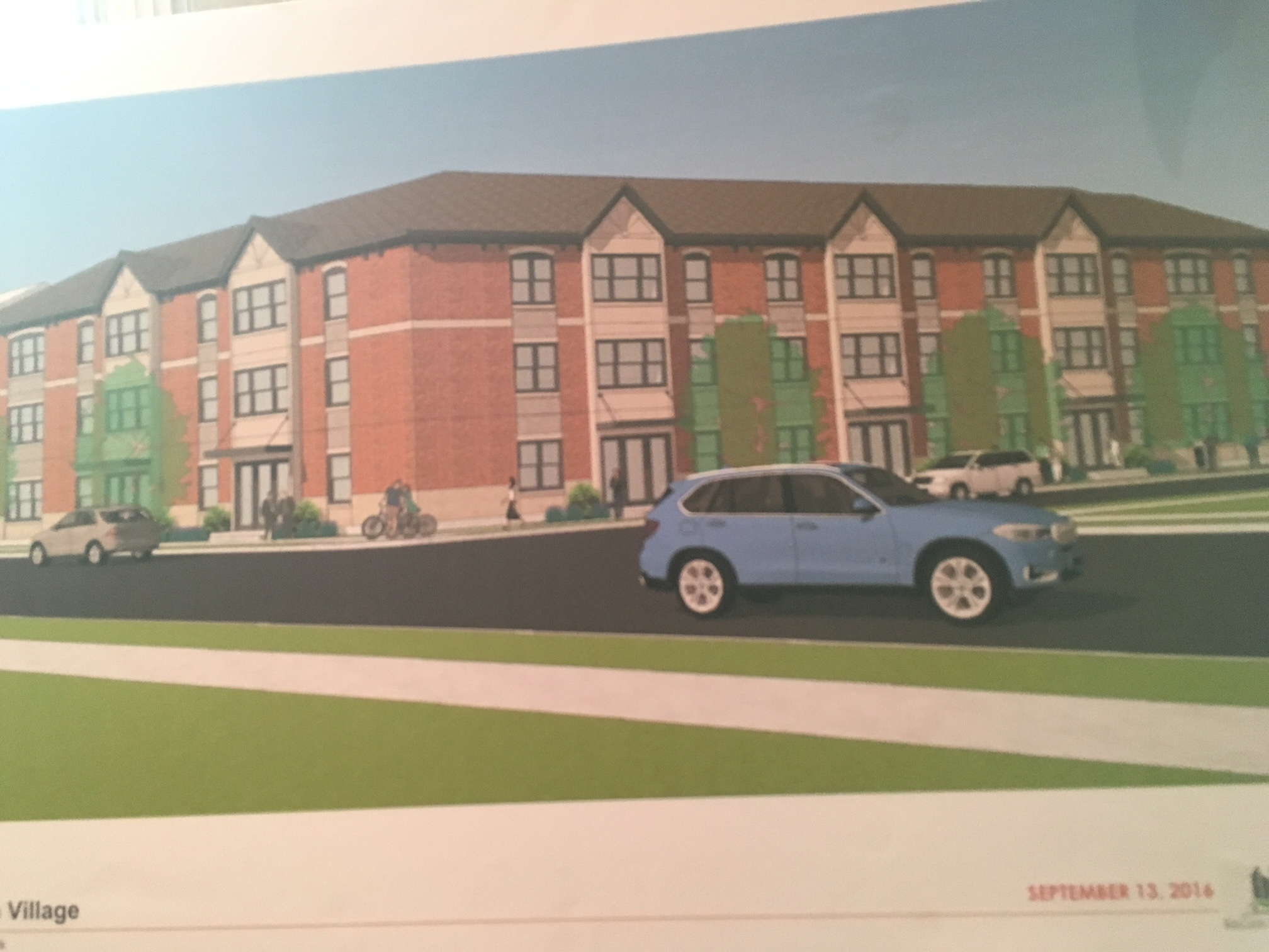 A rendering of the proposed 65-unit apartment complex on Genesee and Grey streets.