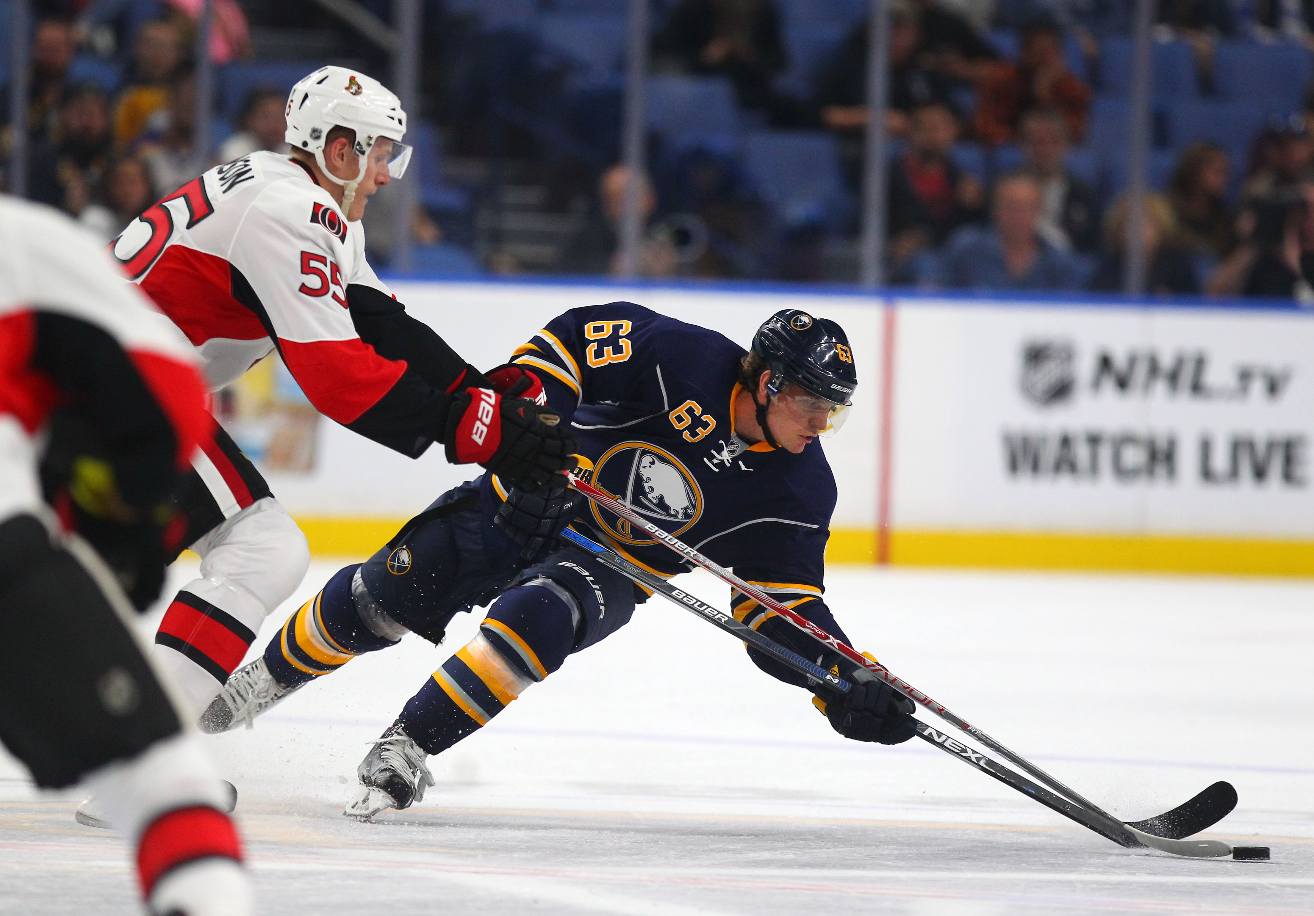 The Sabres' Tyler Ennis tries to get past the Senators' Buddy Robinson in the first period of the game at the KeyBank Center in Buffalo Tuesday, Sept. 27, 2016.  (Mark Mulville/Buffalo News)